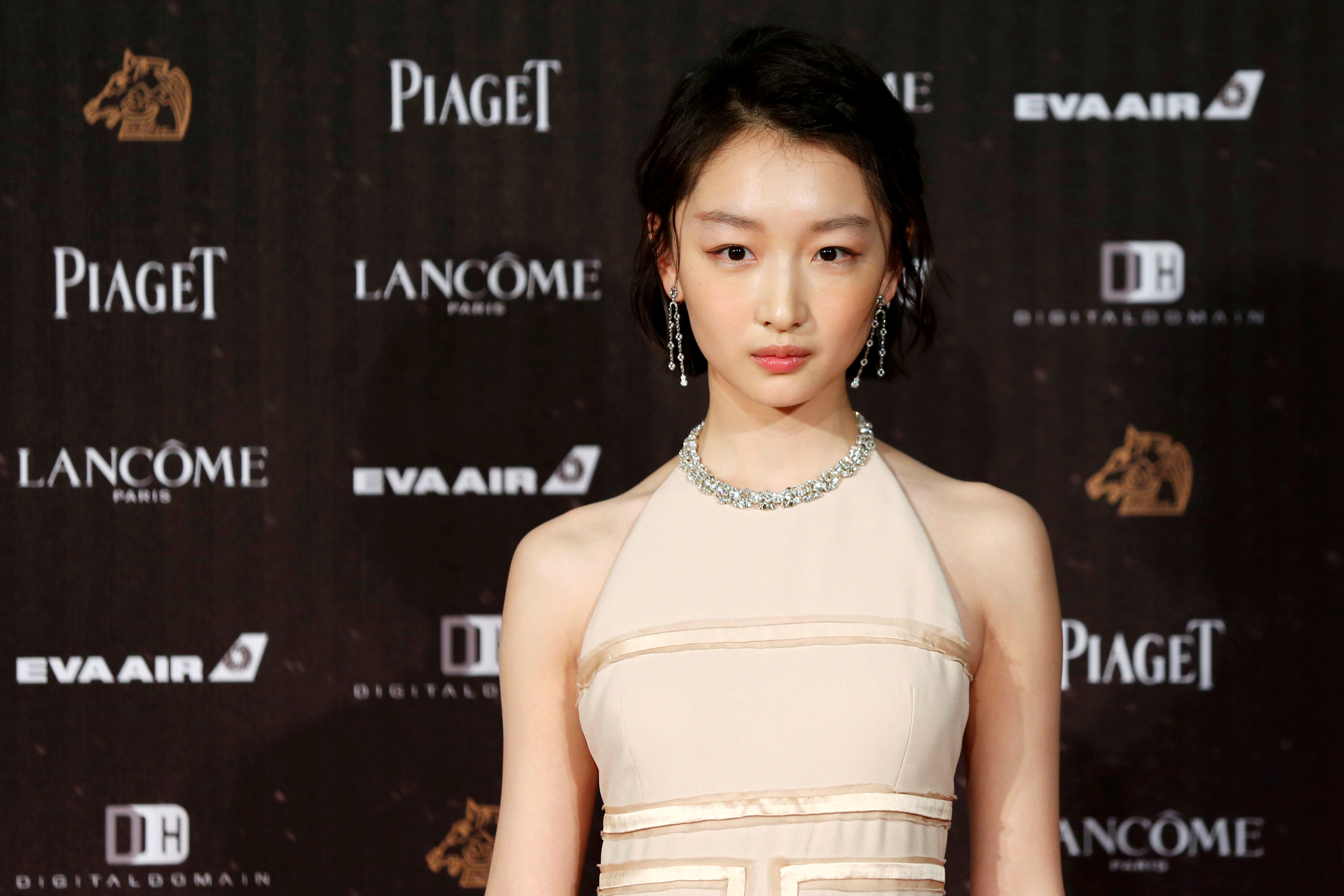 Actor Zhou Dongyu poses on the red carpet at the 53rd Golden Horse Awards in Taipei, Taiwan November 26, 2016. REUTERS/Tyrone Siu/File Photo