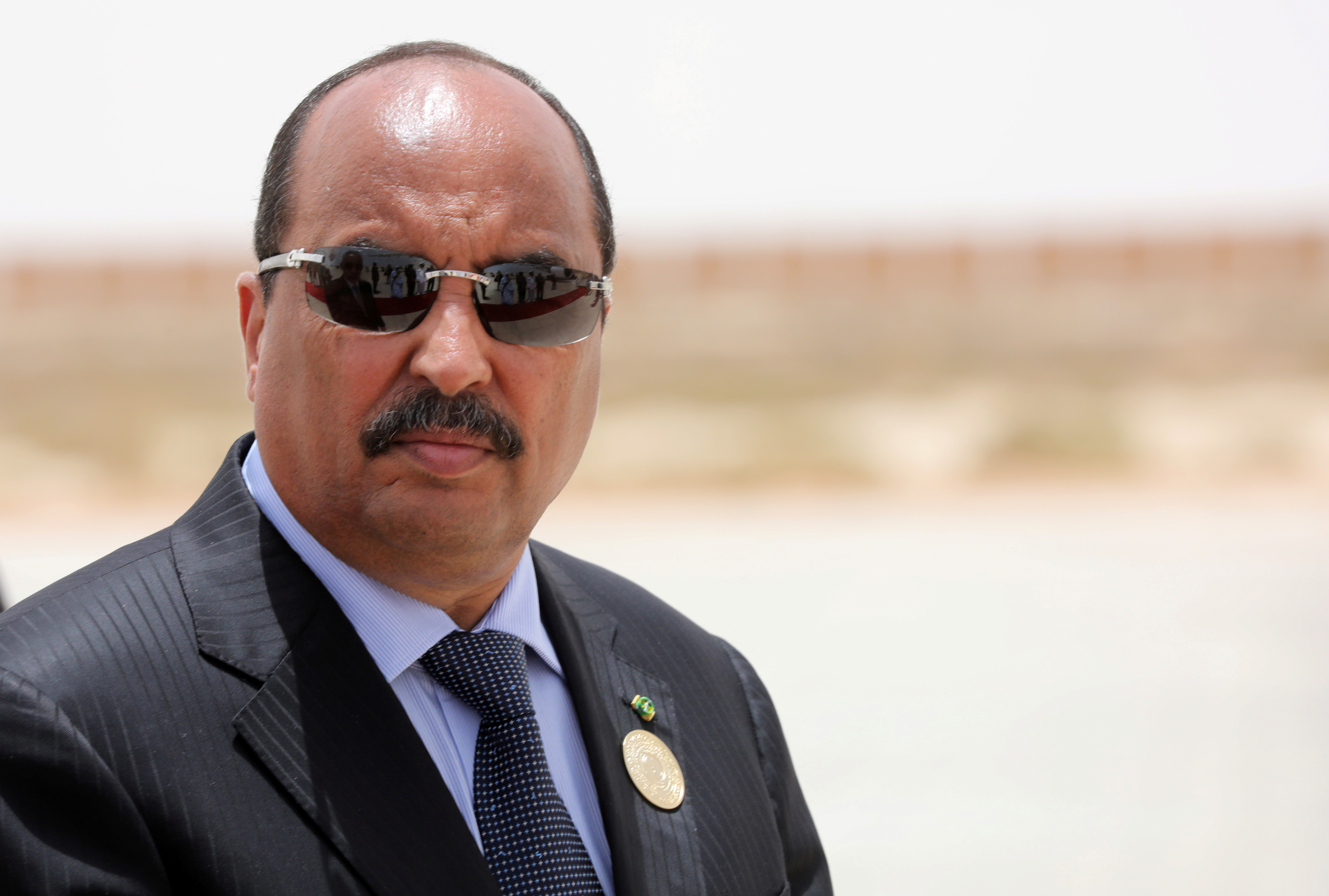 Mauritanian President Mohamed Ould Abdel Aziz waits the arrival of his French counterpart  Emmanuel Macron at Nouakchott airport, Mauritania, July 2, 2018.  Ludovic Marin/Pool via Reuters/File Photo