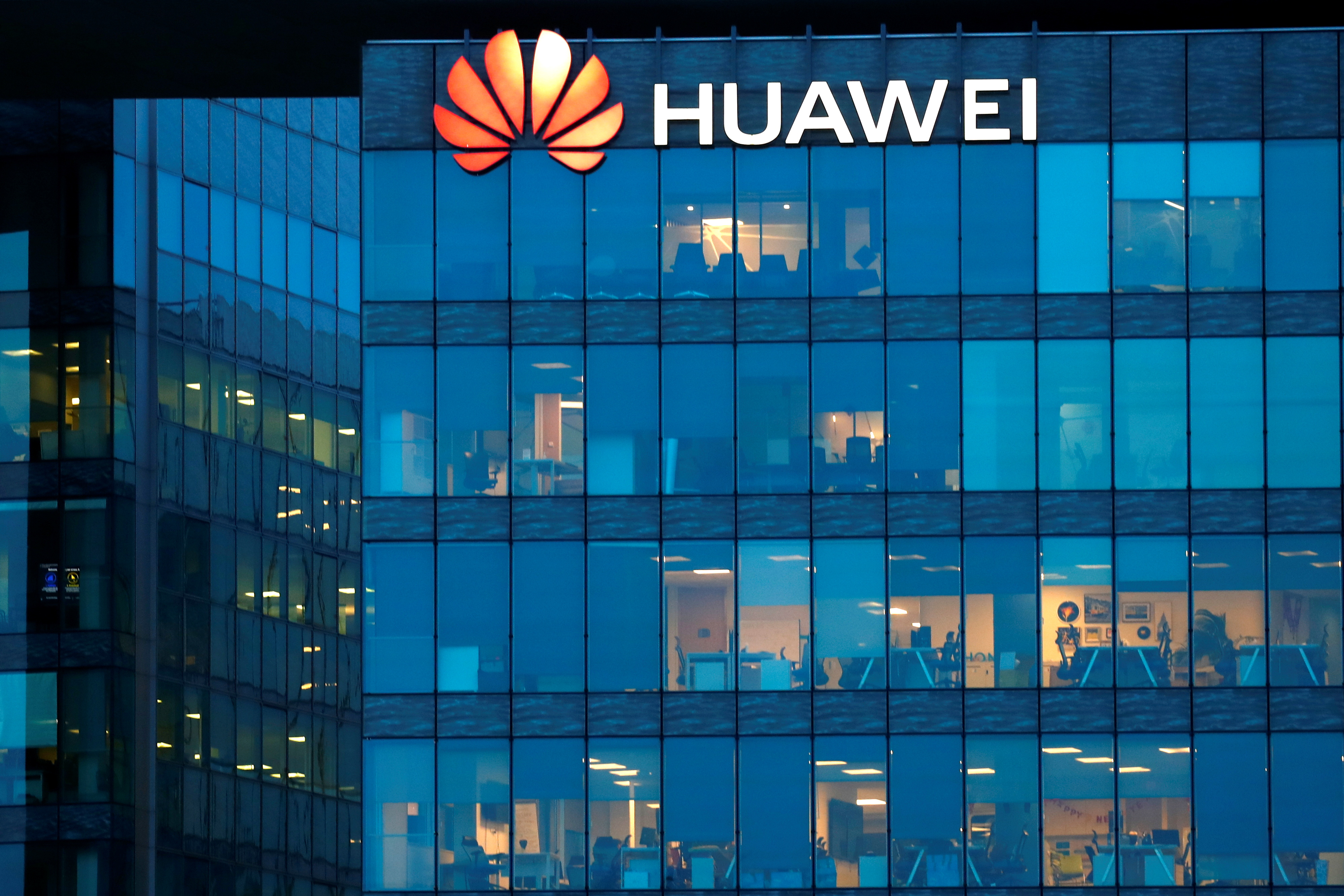 A view shows a Huawei logo at Huawei Technologies France headquarters in Boulogne-Billancourt near Paris, France, February 17, 2021. REUTERS/Gonzalo Fuentes