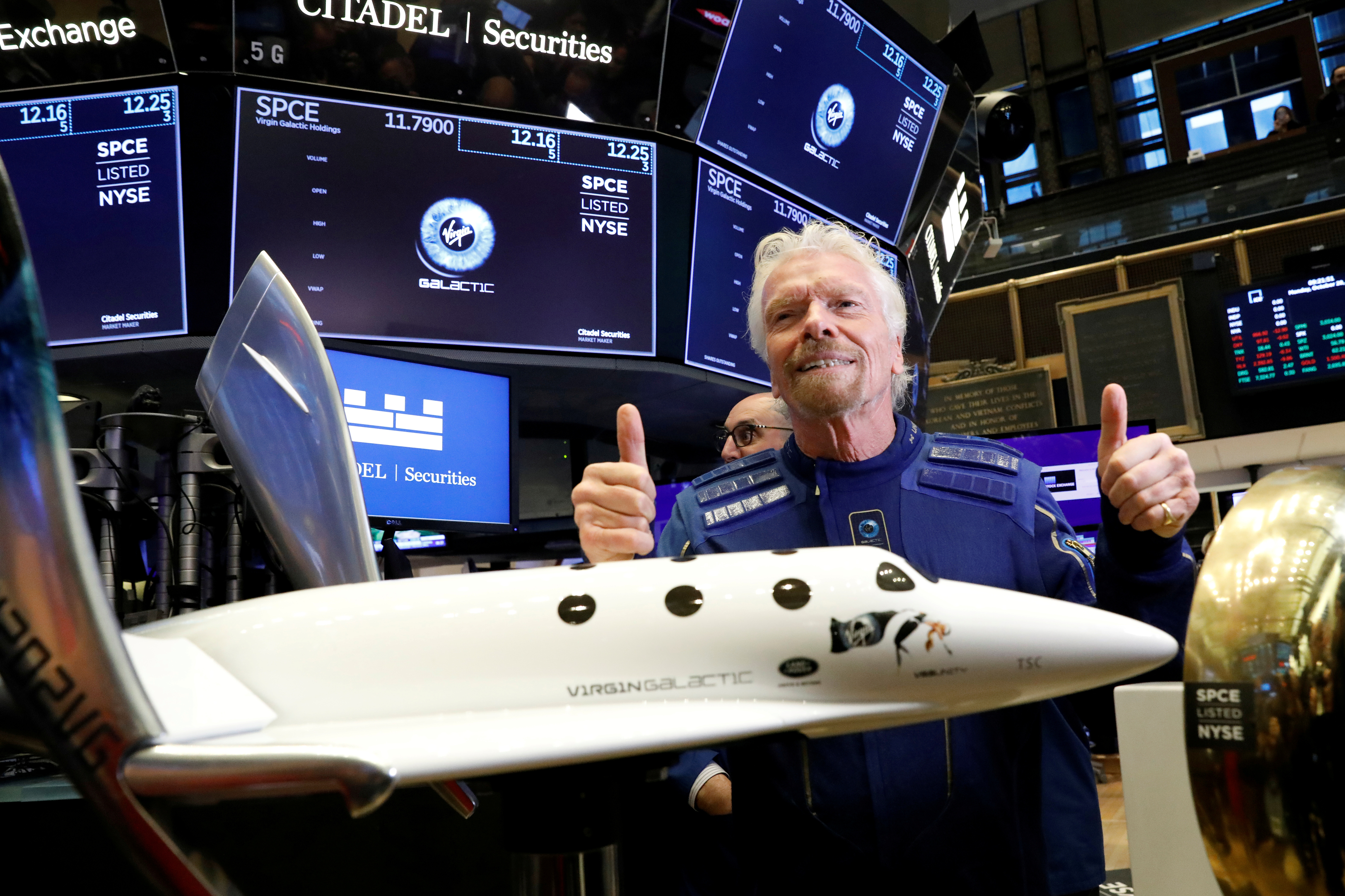 Sir Richard Branson poses on the floor of the New York Stock Exchange (NYSE) ahead of Virgin Galactic (SPCE) trading in New York, U.S., October 28, 2019. REUTERS/Brendan McDermid