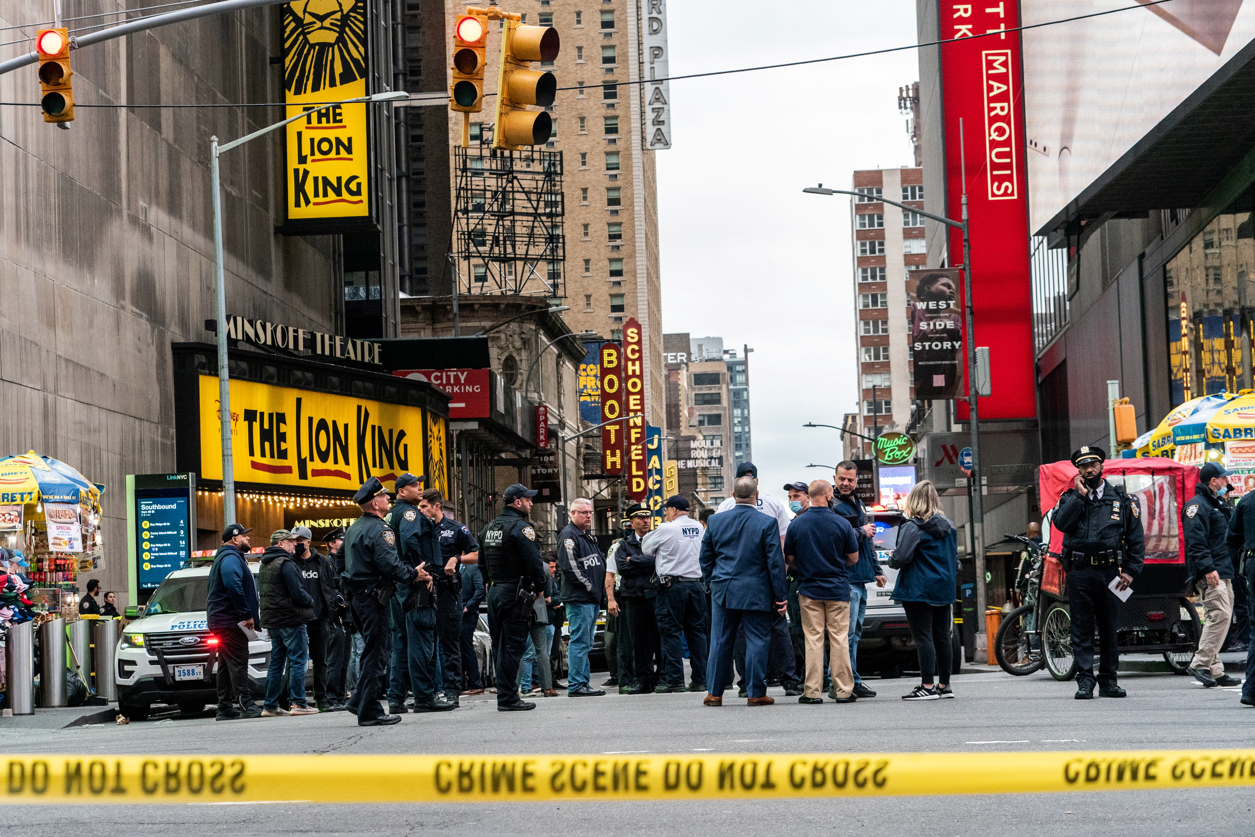 New York City police officers stand guard after a shooting incident in Times Square, New York, U.S., May 8, 2021. REUTERS/Jeenah Moon
