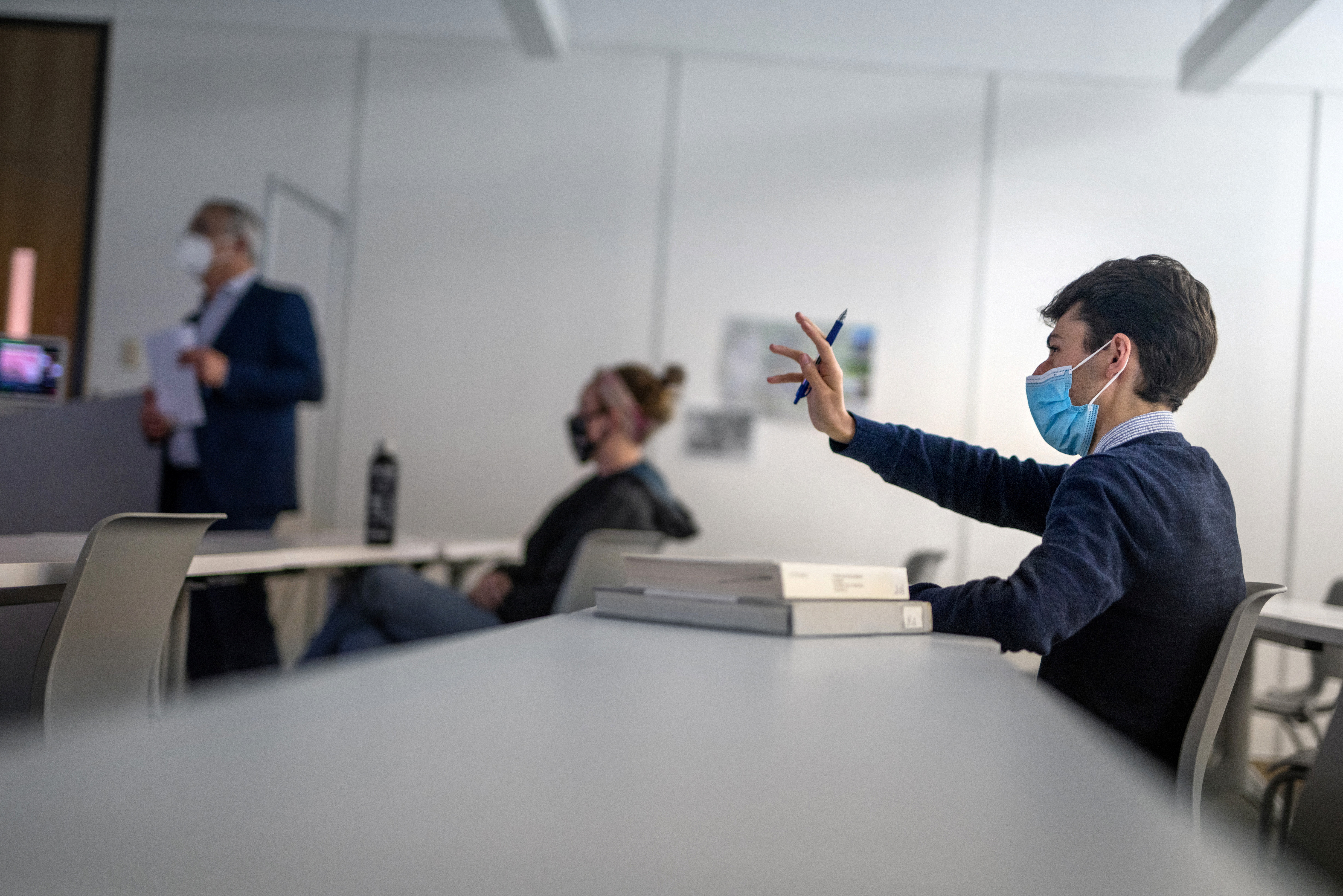 President of the College Republicans at LSU Ben Smith attends an art history class taught by Ludovico Geymonat (L) at Louisiana State University in Baton Rouge, Louisiana, U.S., April 13, 2021.  REUTERS/Kathleen Flynn