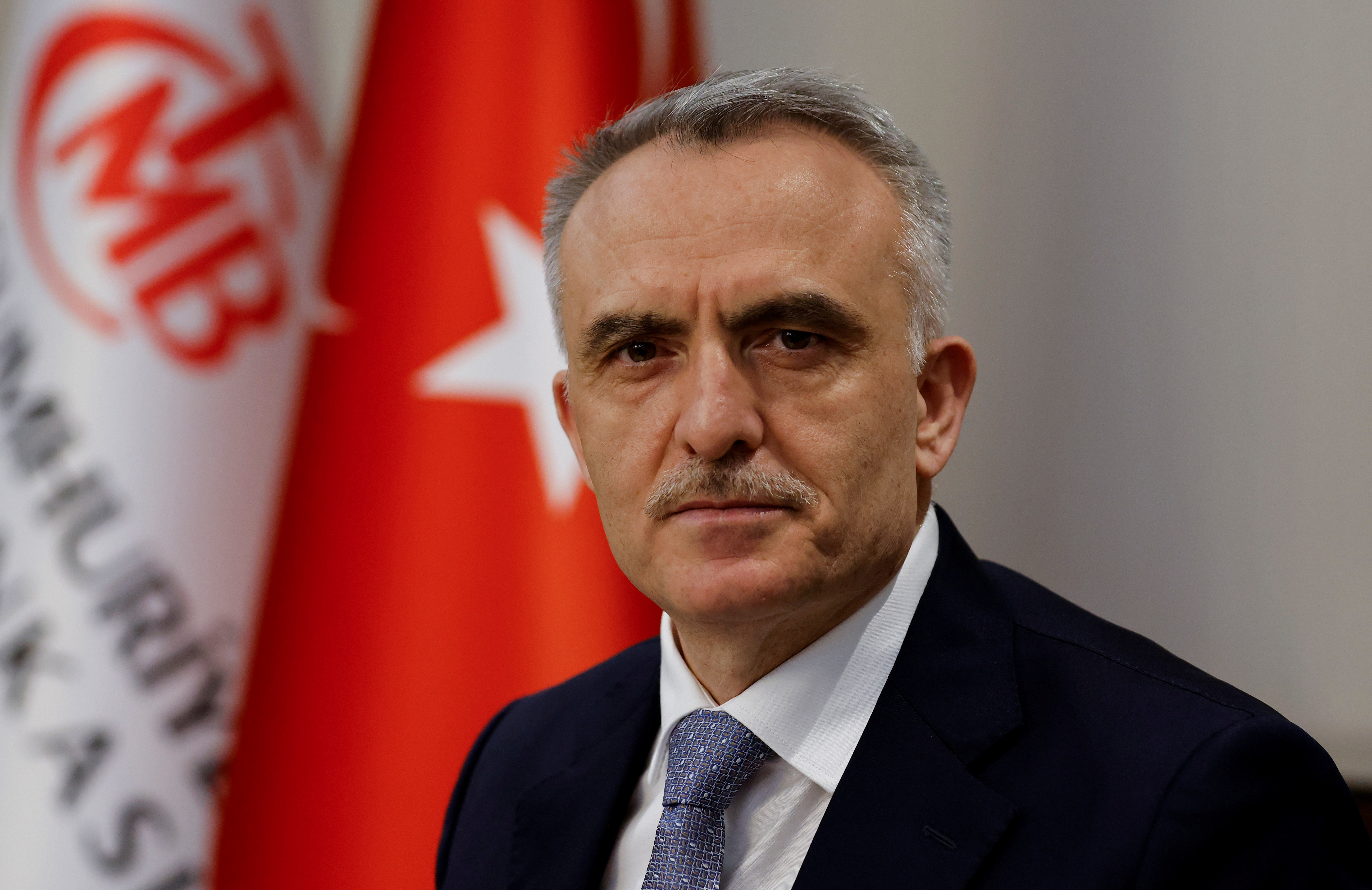 Turkey's Central Bank Governor Naci Agbal poses during an interview with Reuters in his office in Istanbul, Turkey, February 4, 2021. Picture taken February 4, 2021. REUTERS/Umit Bektas/File Photo