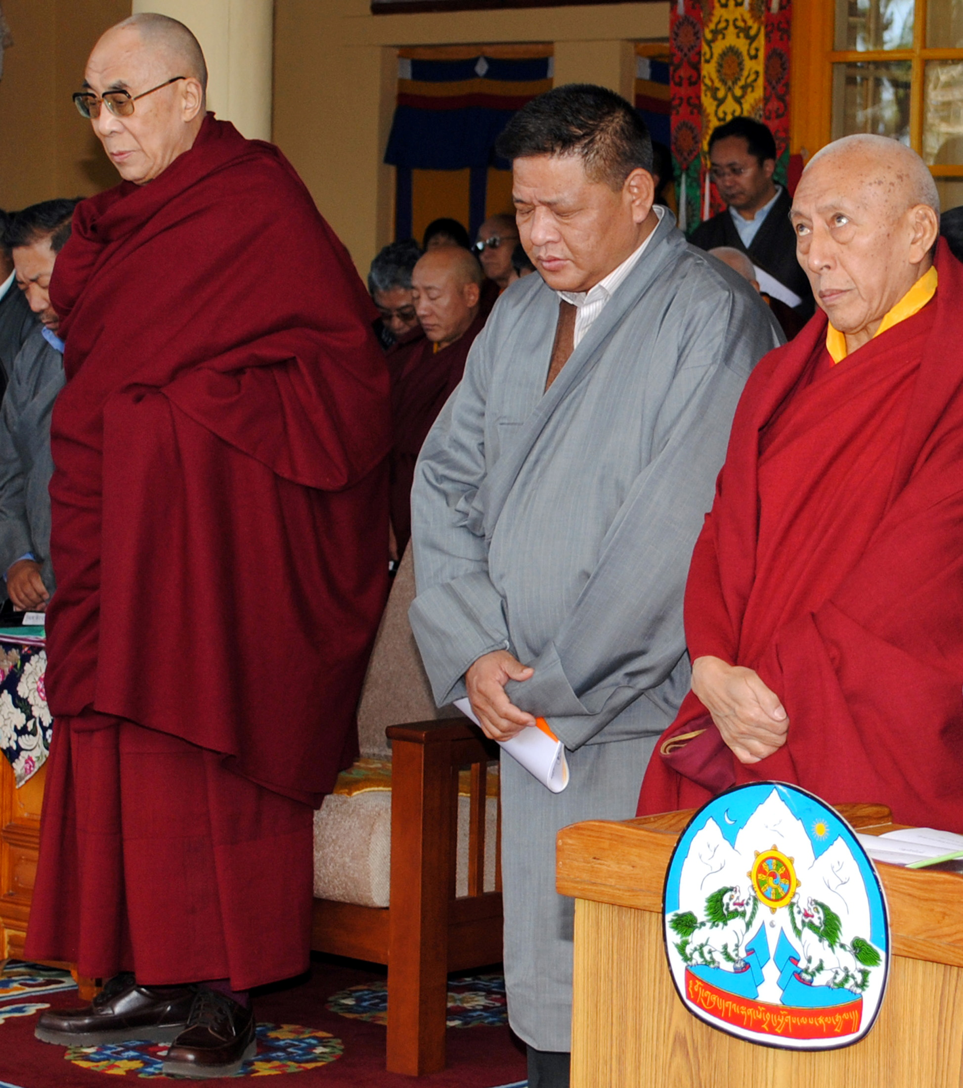 Tibet's exiled Buddhist spiritual leader the Dalai Lama, Penpa Tsering (in grey), speaker of the Tibetan Parliament-in-exile and Samdhong Rinpoche (R), Prime Minister of the Tibetan government-in-exile, observe a minute's silence during a ceremony in the northern Indian hilltown of Dharamsala March 10, 2011. REUTERS/Stringer