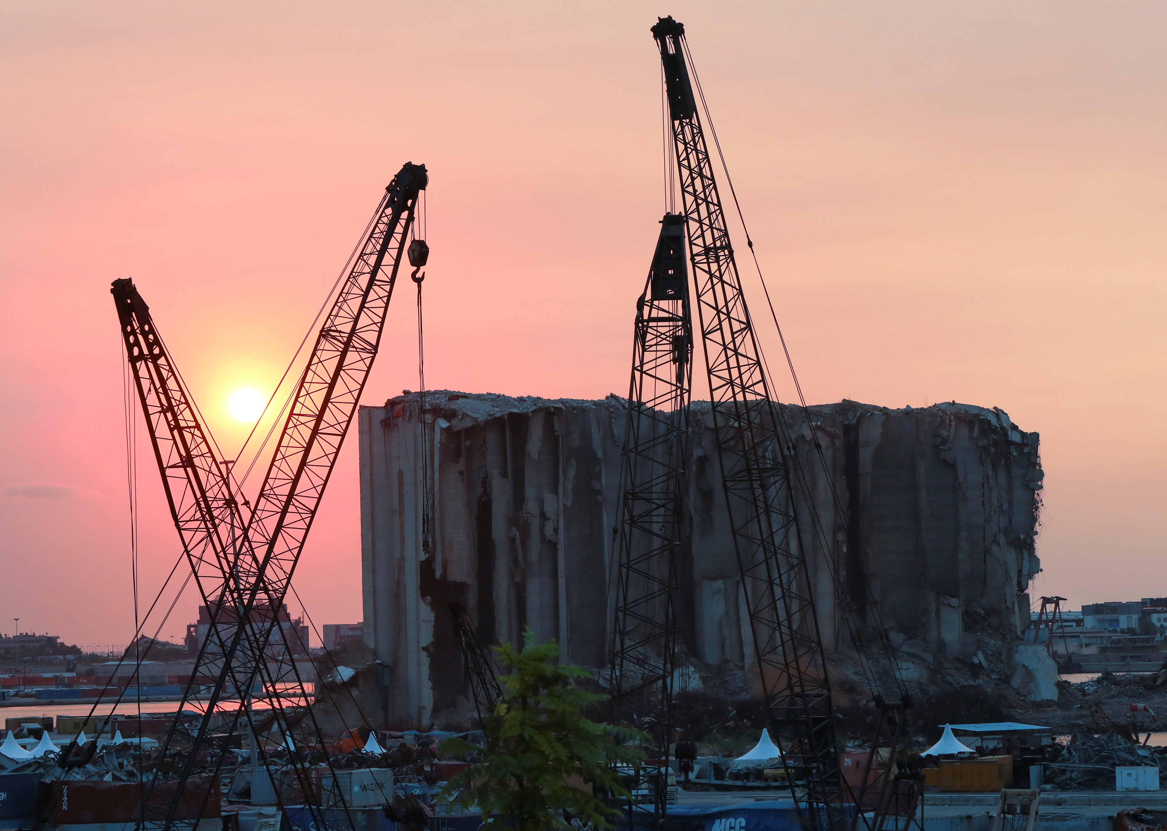 A view shows the grain silo that was damaged during last year's Beirut port blast, during sunset in Beirut, Lebanon, July 29, 2021. Picture taken July 29, 2021. REUTERS/Mohamed Azakir