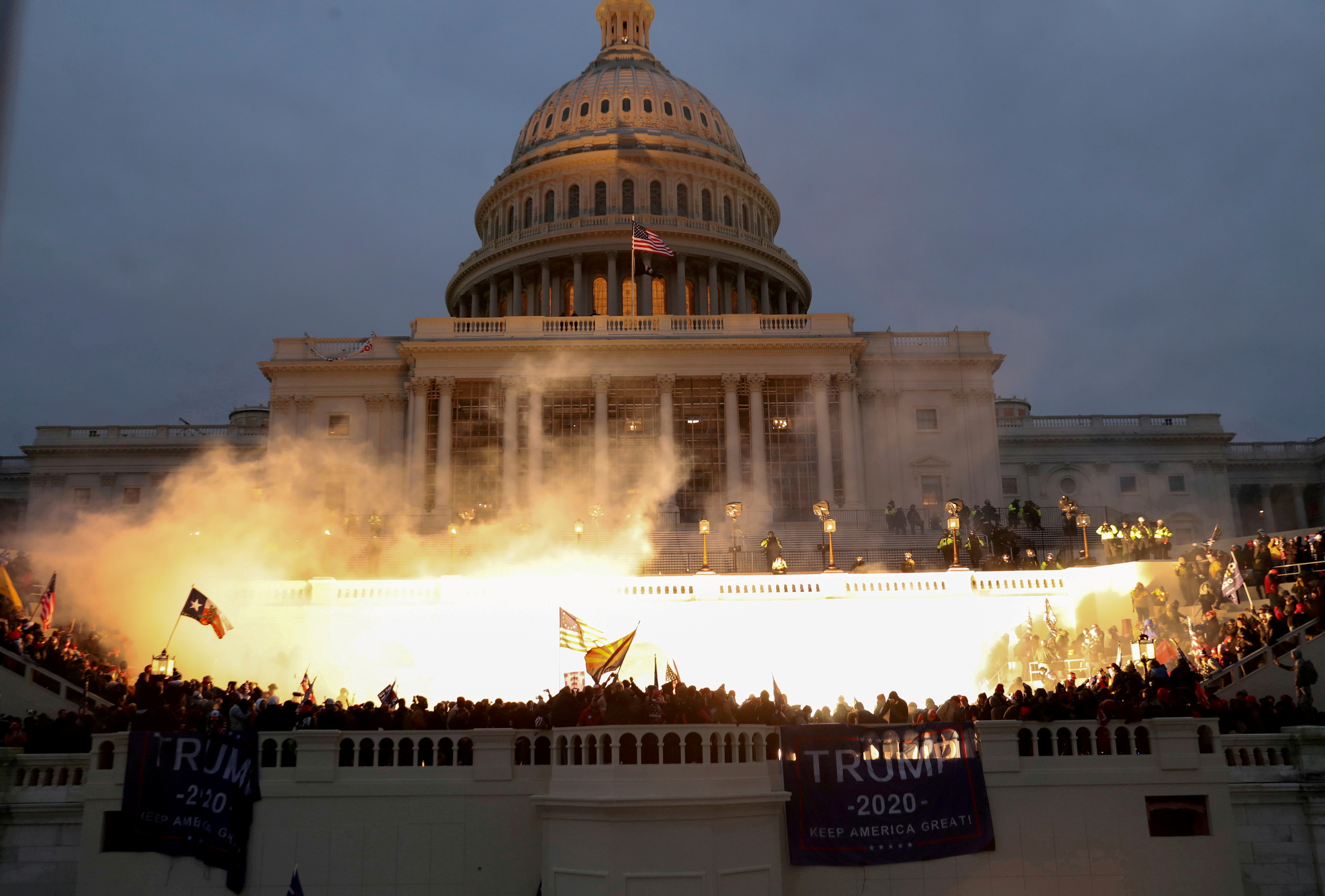 An explosion caused by a police munition is seen while supporters of U.S. President Donald Trump gather in front of the U.S. Capitol Building in Washington, U.S., January 6, 2021. REUTERS/Leah Millis/File Photo/File Photo