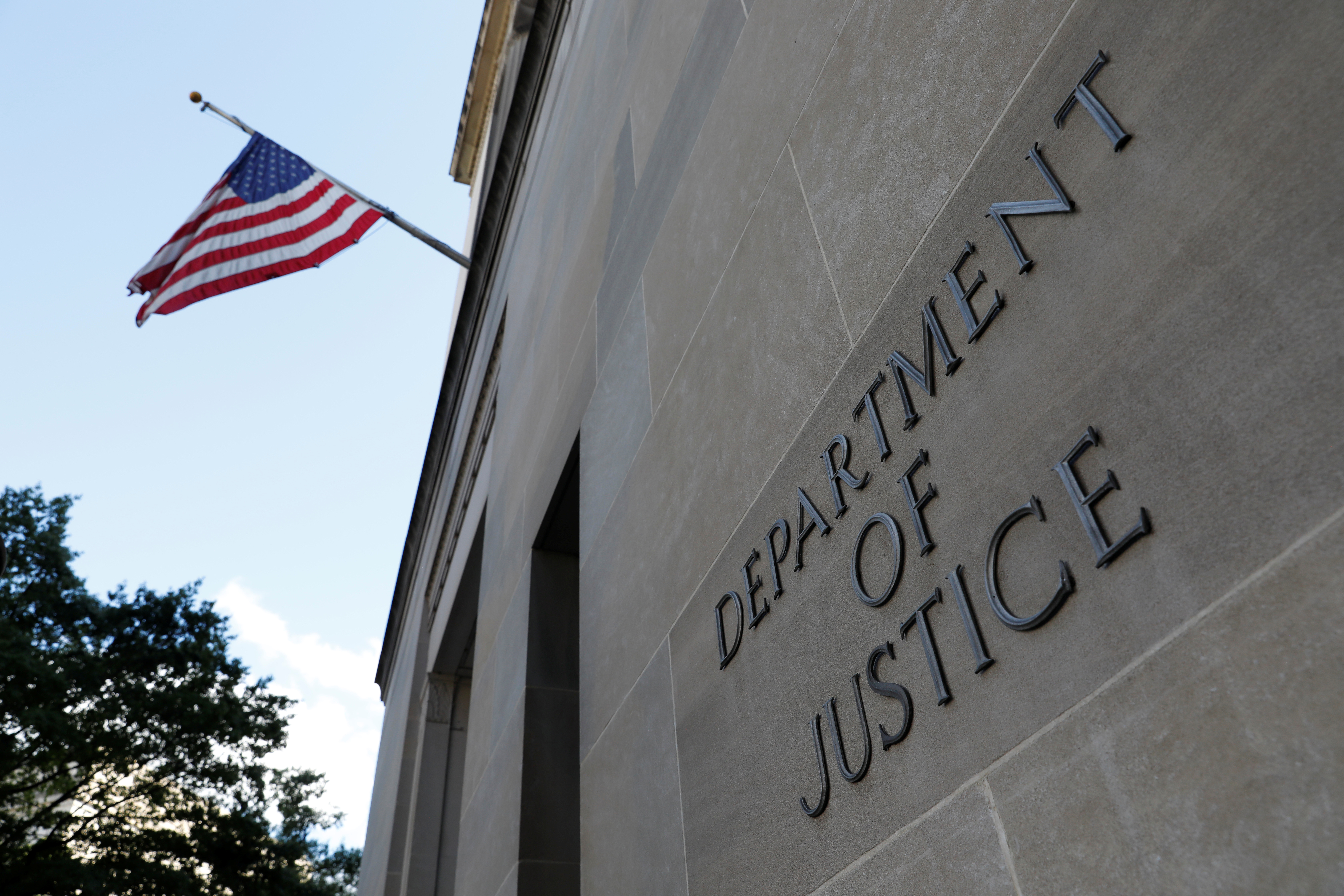 Signage is seen at the United States Department of Justice headquarters in Washington, D.C., U.S., August 29, 2020. REUTERS/Andrew Kelly