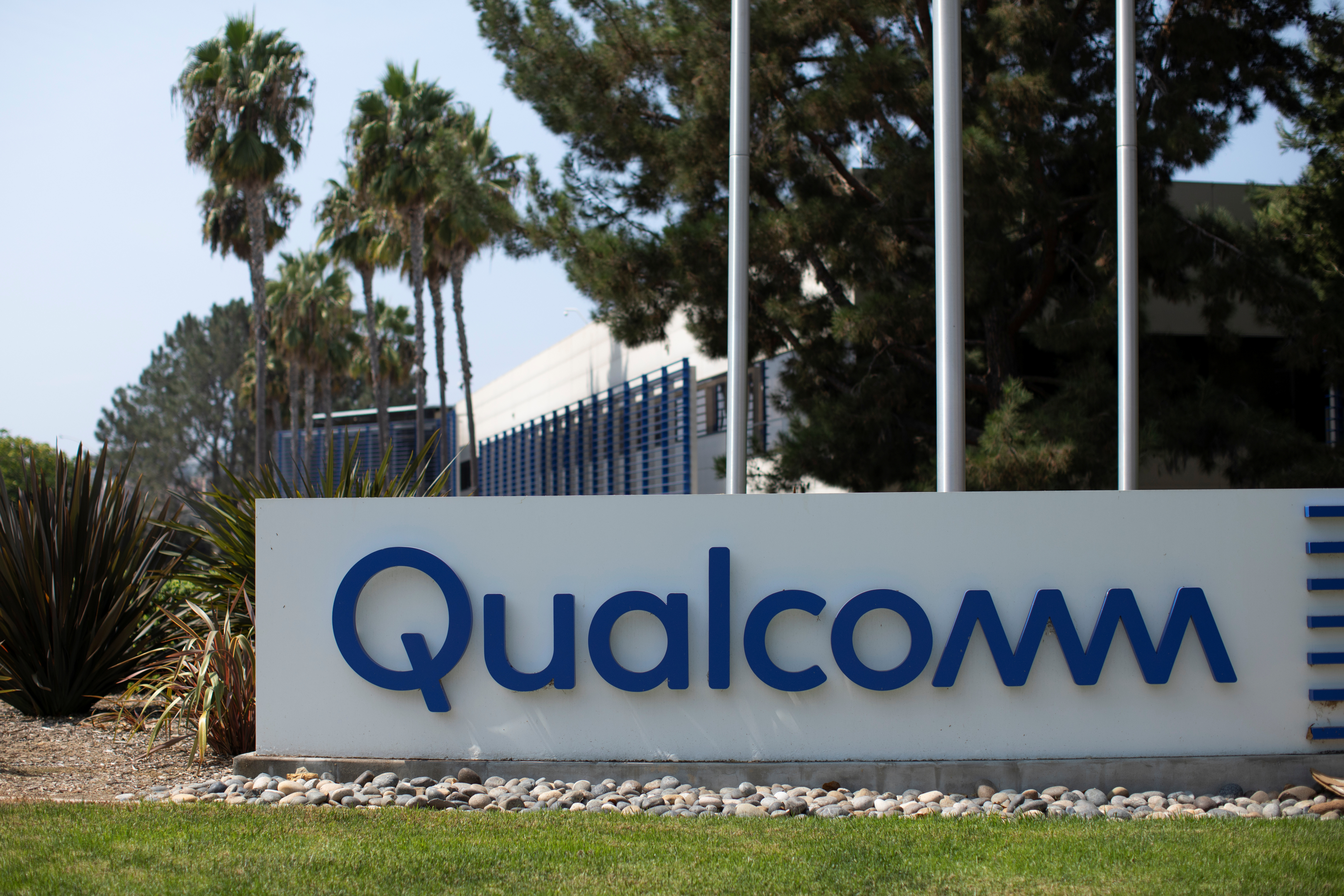 A Qualcomm sign is shown outside one of the company's many buildings in San Diego, California, U.S., September 17, 2020. REUTERS/Mike Blake
