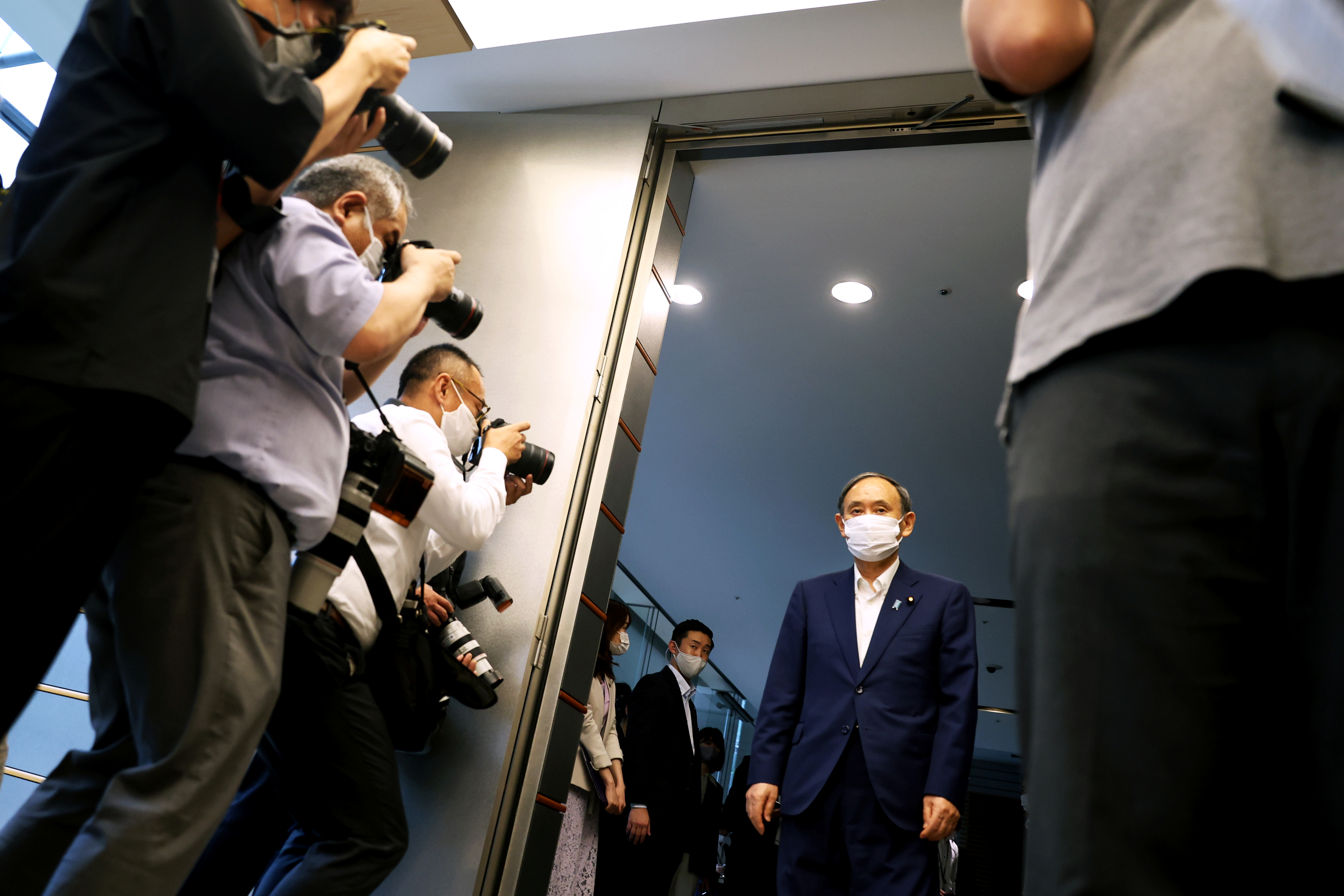 Japan's Prime Minister Yoshihide Suga arrives to meet with president of the International Paralympic Committee (IPC) Andrew Parsons in Tokyo, Japan September 3, 2021, following his announcement that he will not seek re-election for Liberal Democratic Party (LDP) leadership this month. Behrouz Mehri/Pool via REUTERS
