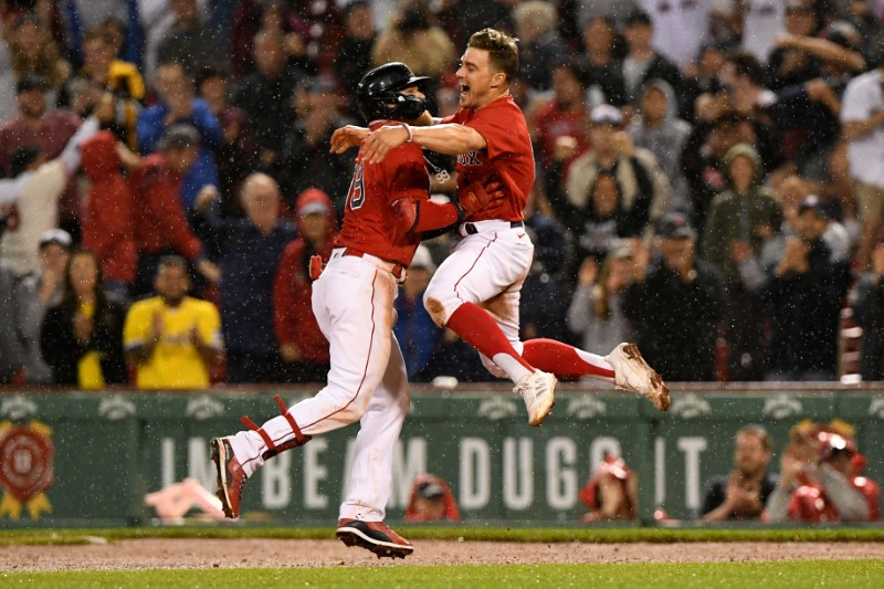 Jun 11, 2021; Boston, Massachusetts, USA; Boston Red Sox center fielder Alex Verdugo (99) celebrates with center fielder Enrique Hernandez (5) after hitting a walk-off single against the Toronto Blue Jays during the ninth inning at Fenway Park. Mandatory Credit: Brian Fluharty-USA TODAY Sports