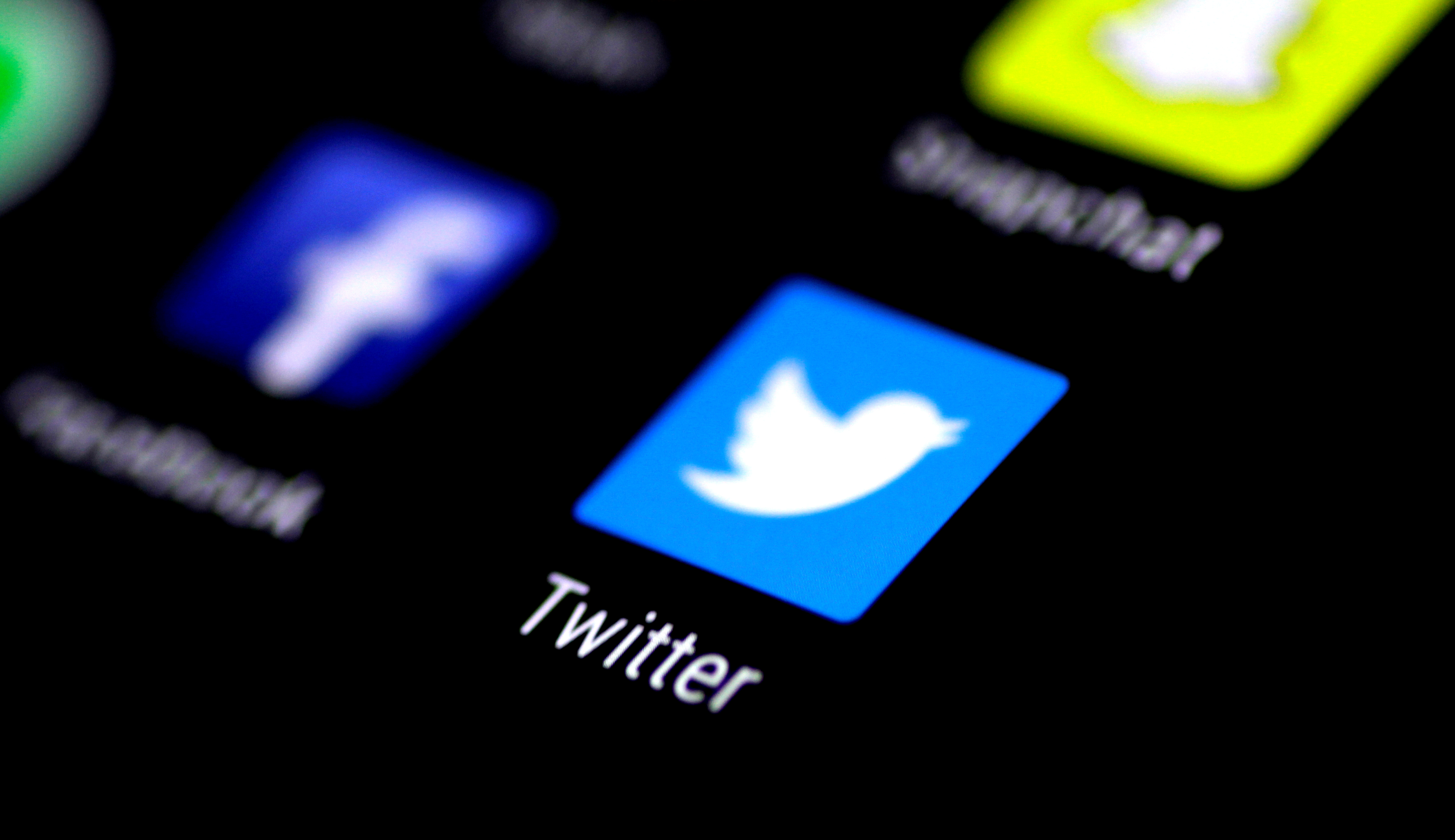 The Twitter application is seen on a phone screen August 3, 2017.   REUTERS/Thomas White/File Photo