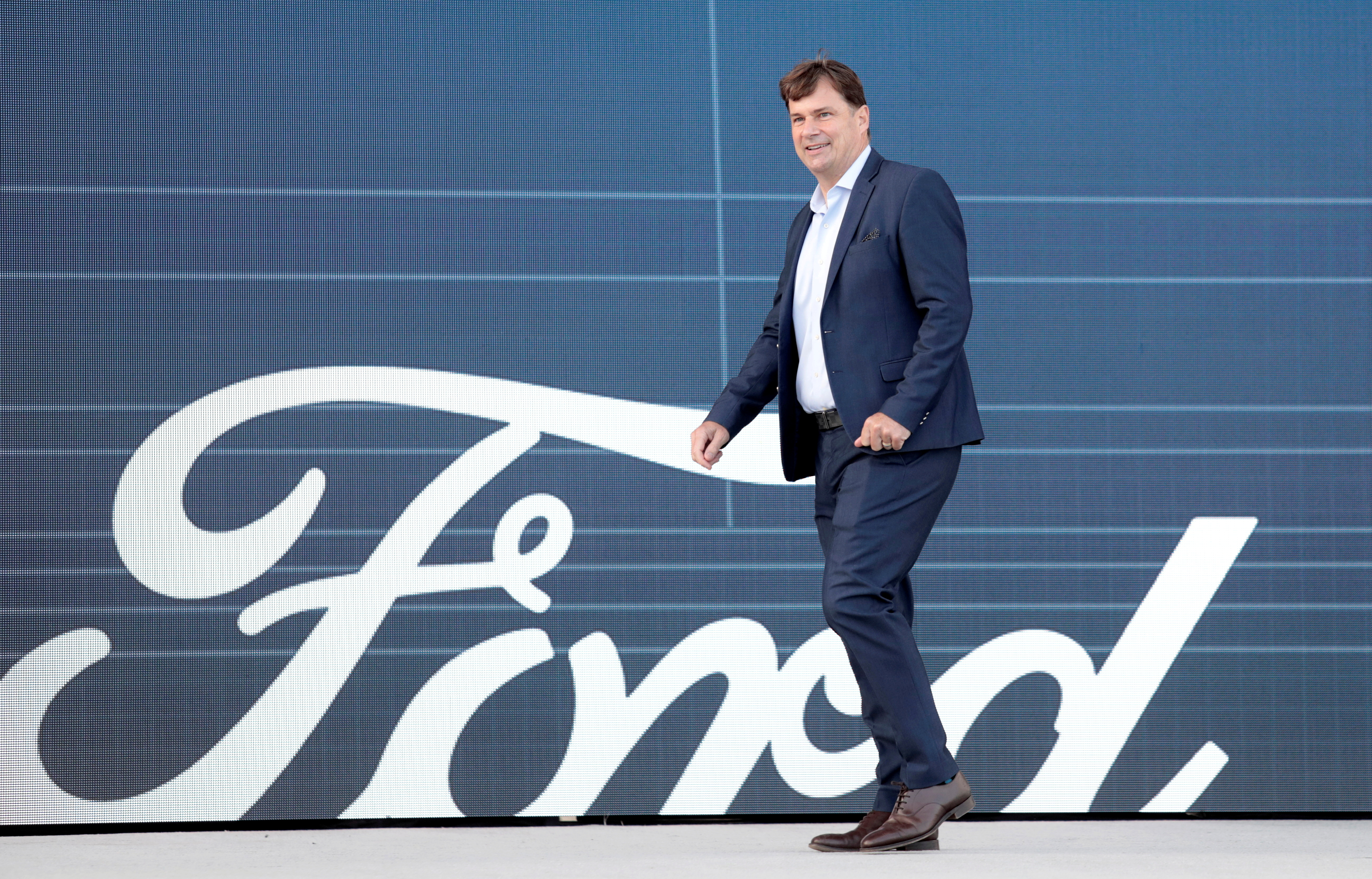 Ford Motor Co. CEO Jim Farley walks to speak at a news conference at the Rouge Complex in Dearborn, Michigan, U.S. September 17, 2020. REUTERS/Rebecca Cook/File Photo