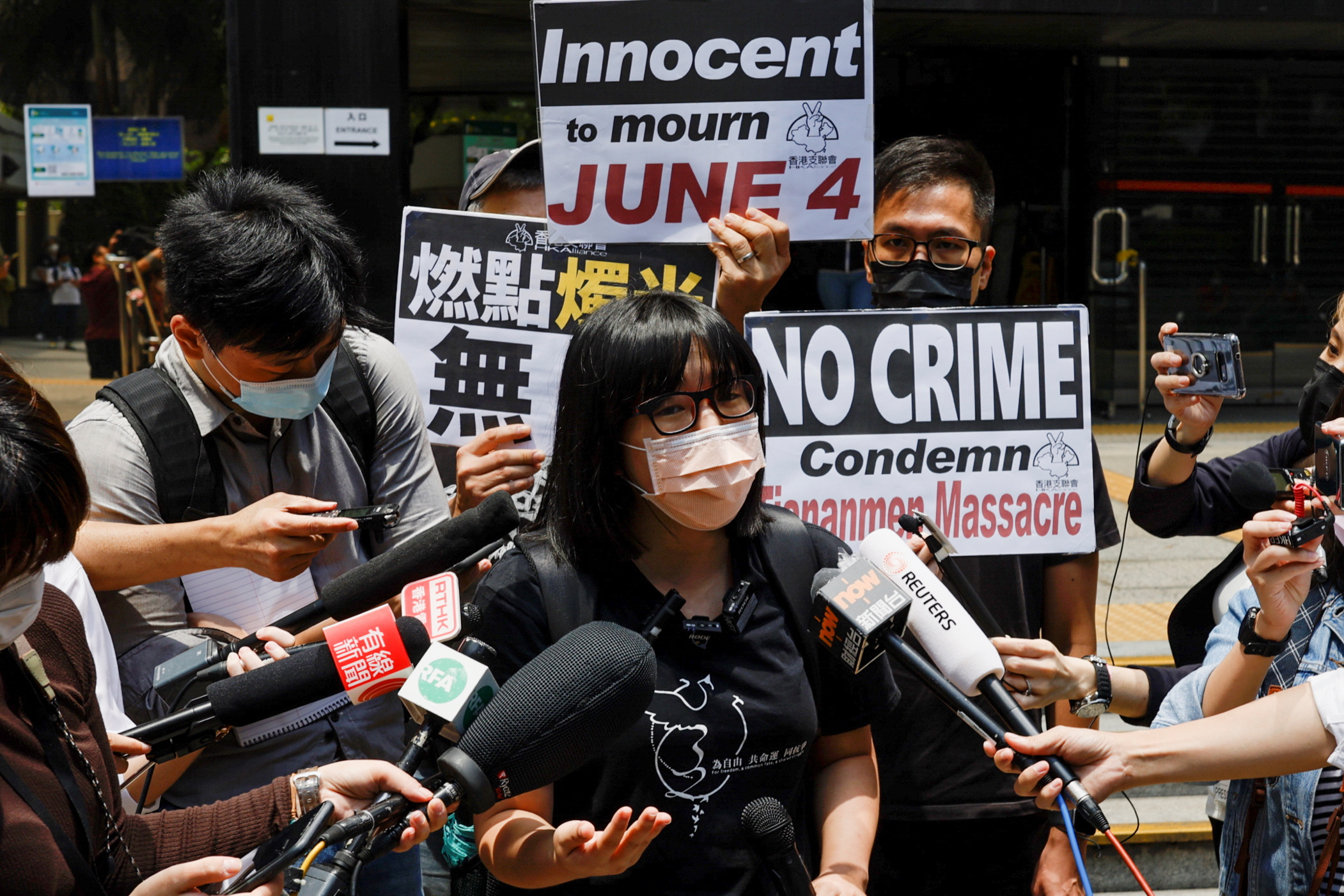 Vice-chairwoman of Hong Kong Alliance in Support of Patriotic Democratic Movements of China, Chow Hang-tung speaks to media after activist Joshua Wong was jailed for participating on June 4 assembly to commemorate the 1989 crackdown on protesters in and around Beijing's Tiananmen Square, outside the court in Hong Kong, China May 6, 2021. REUTERS/Tyrone Siu