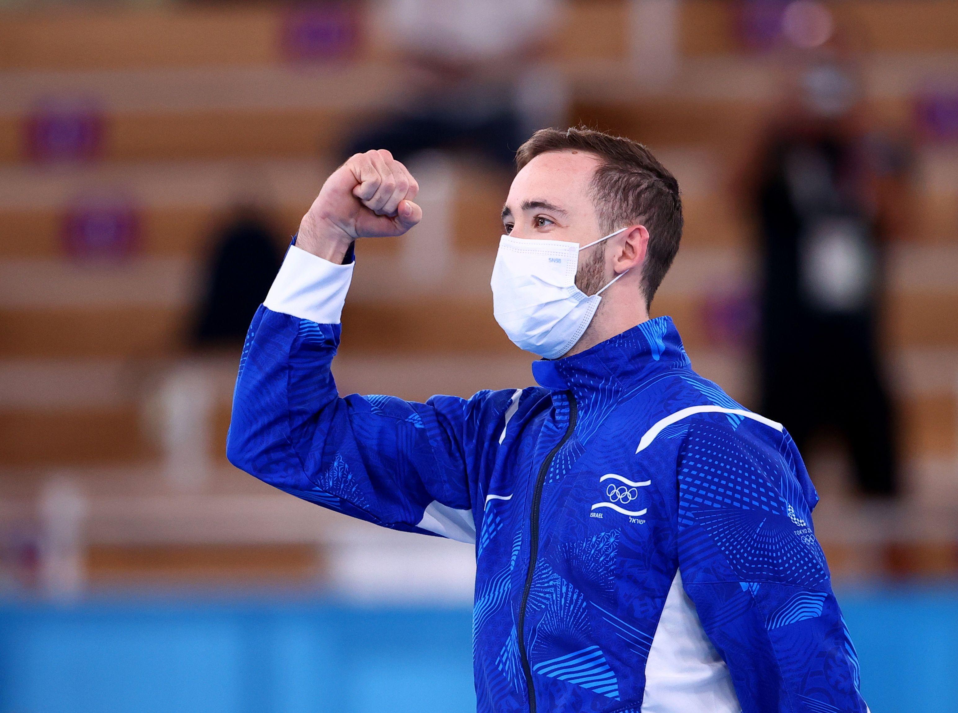 Tokyo 2020 Olympics - Gymnastics - Artistic - Men's Floor Exercise - Medal Ceremony - Ariake Gymnastics Centre, Tokyo, Japan - August 1, 2021.  Gold medallist Artem Dolgopyat of Israel wearing a protective face mask reacts. REUTERS/Lindsey Wasson