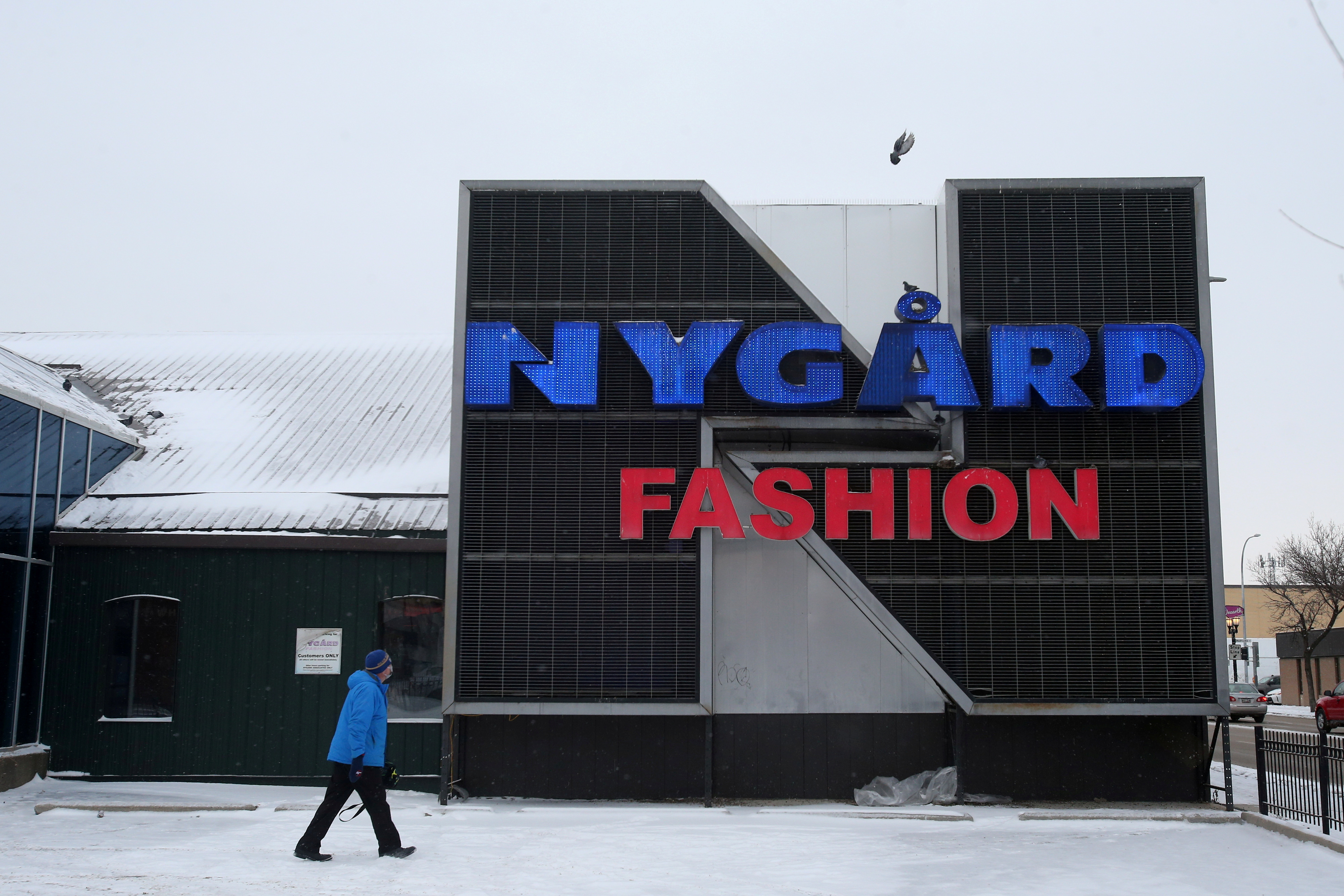The name of fashion executive and designer Peter Nygard is illuminated on a flagship store he once owned in Winnipeg, Manitoba, Canada December 15, 2020. REUTERS/Shannon VanRaes/File Photo