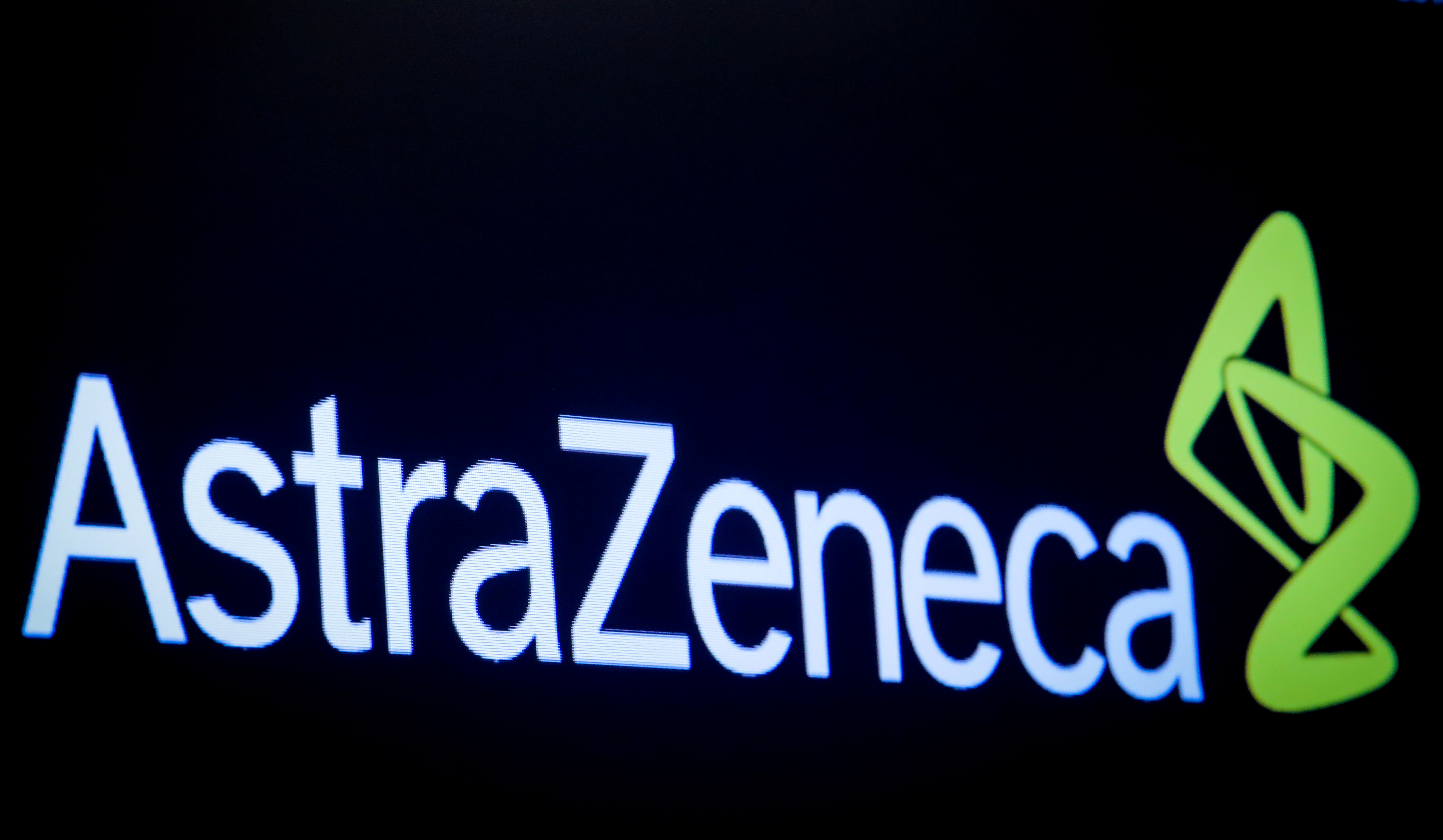 The company logo for pharmaceutical company AstraZeneca is displayed on a screen on the floor at the New York Stock Exchange (NYSE) in New York, U.S., April 8, 2019. REUTERS/Brendan McDermid/File Photo