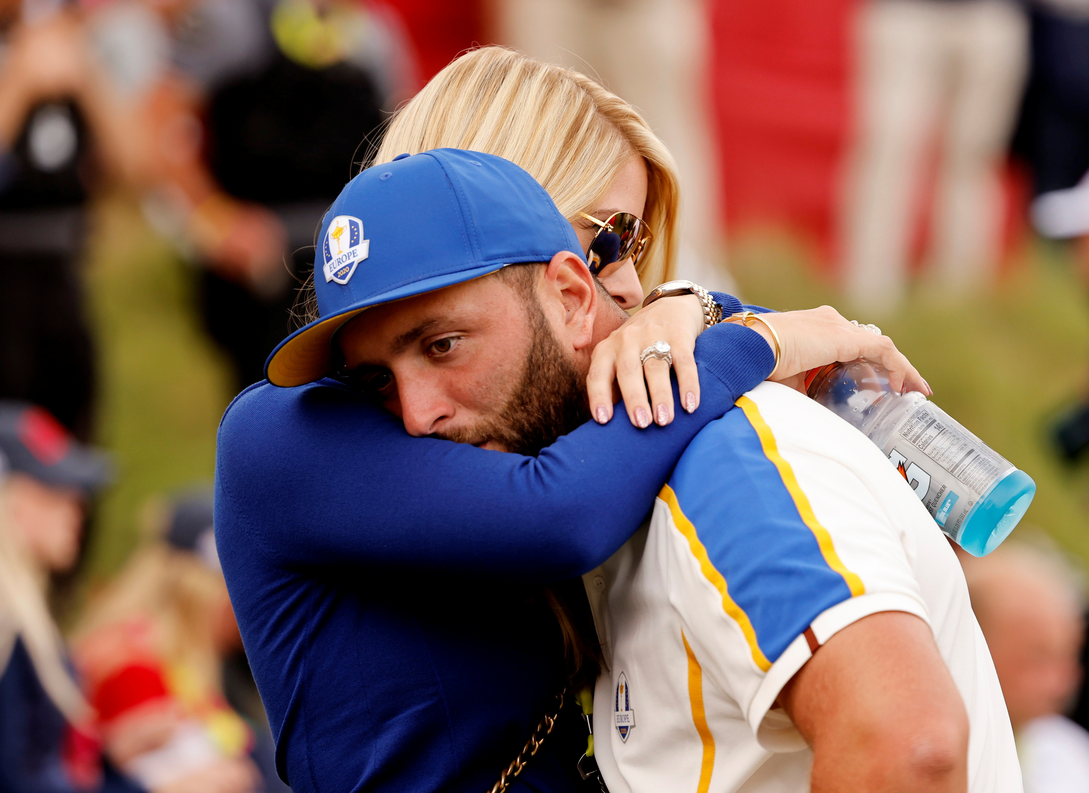 Golf - The 2020 Ryder Cup - Whistling Straits, Sheboygan, Wisconsin, U.S. - September 26, 2021 Team Europe's Jon Rahm is consoled by wife Kelley Cahill after Team USA win The Ryder Cup REUTERS/Jonathan Ernst