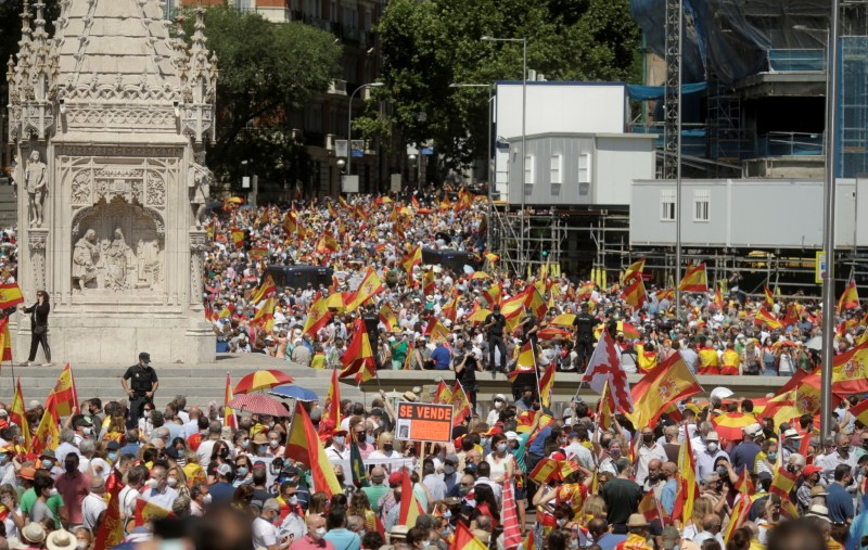 People demonstrate against a plan by the Spanish government to concede pardon to the Catalan politicians who promoted a failed independence declaration of the region in 2017, at Colon Square in Madrid, Spain, June 13, 2021. REUTERS/Javier Barbancho