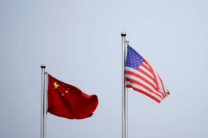 Chinese and U.S. flags flutter outside a company building in Shanghai, China April 14, 2021. REUTERS/Aly Song/File Photo