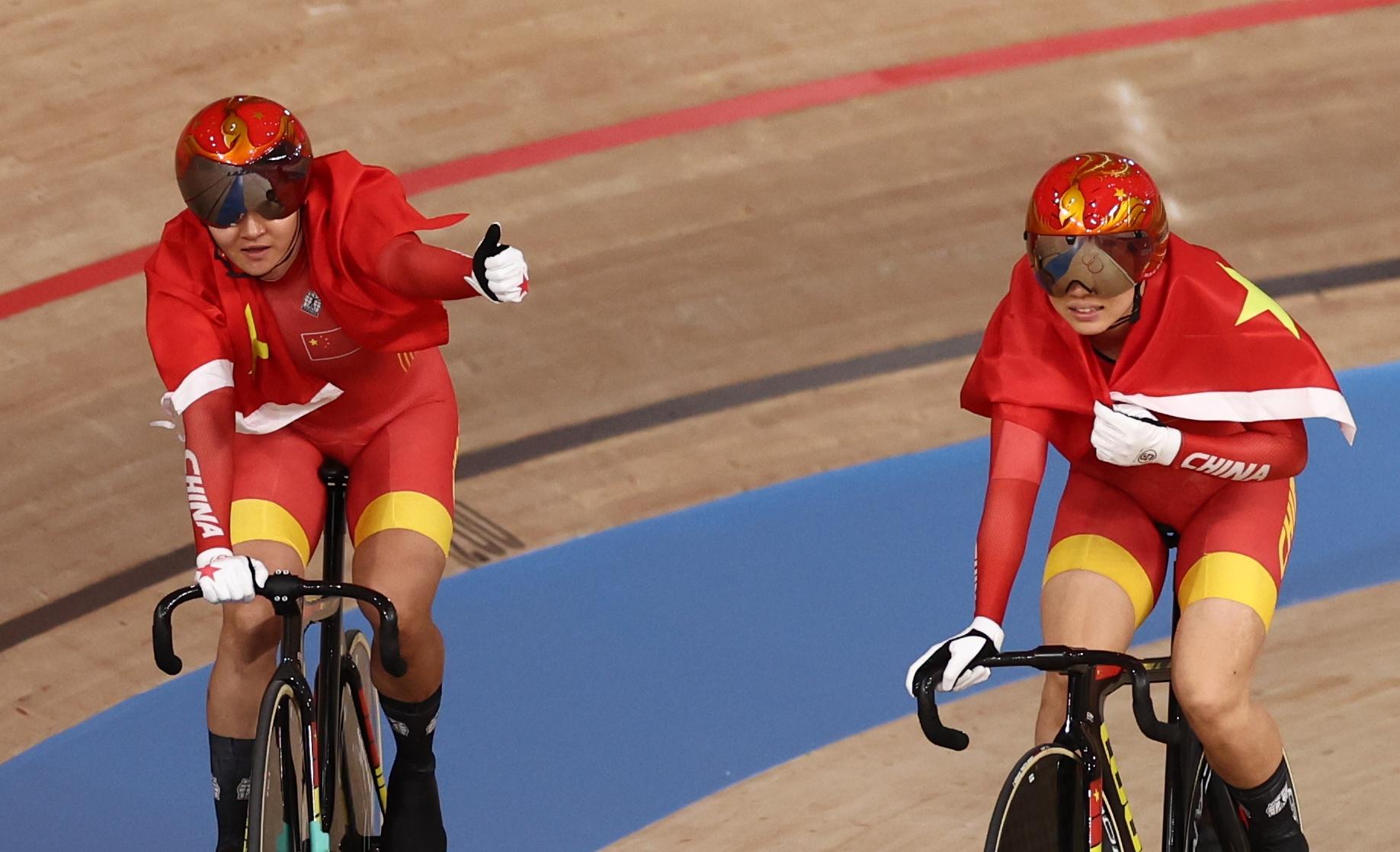 Tokyo 2020 Olympics - Cycling - Track - Women's Team Sprint - Gold Final - Izu Velodrome, Shizuoka, Japan - August 2, 2021. Bao Shanju of China and Zhong Tianshi of China celebrate winning the race and the gold medal REUTERS/Christian Hartmann