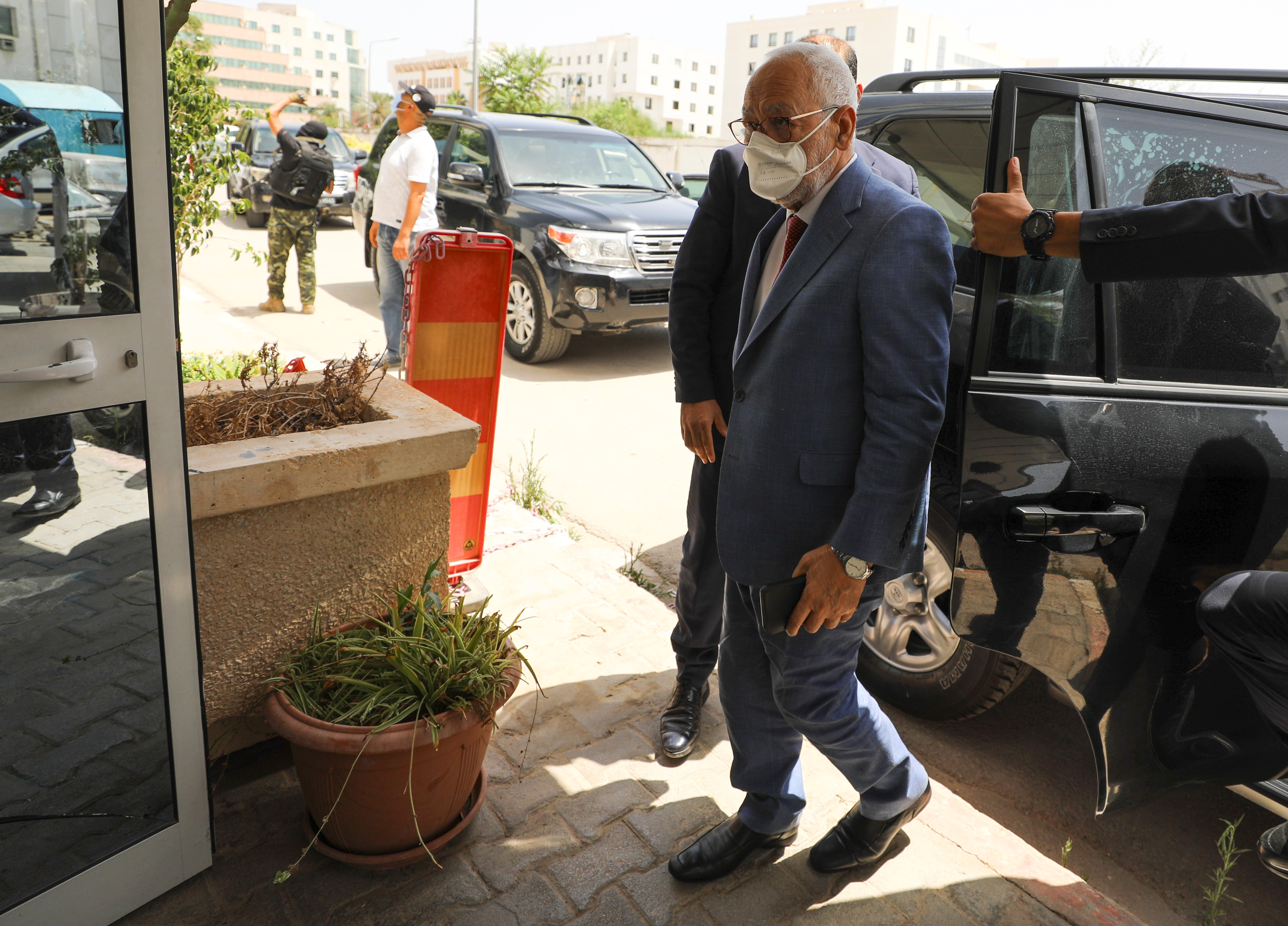Parliament Speaker Rached Ghannouchi, head of the moderate Islamist Ennahda, arrives at the party's headquarters in Tunis, Tunisia, July 29, 2021. REUTERS/Ammar Awad