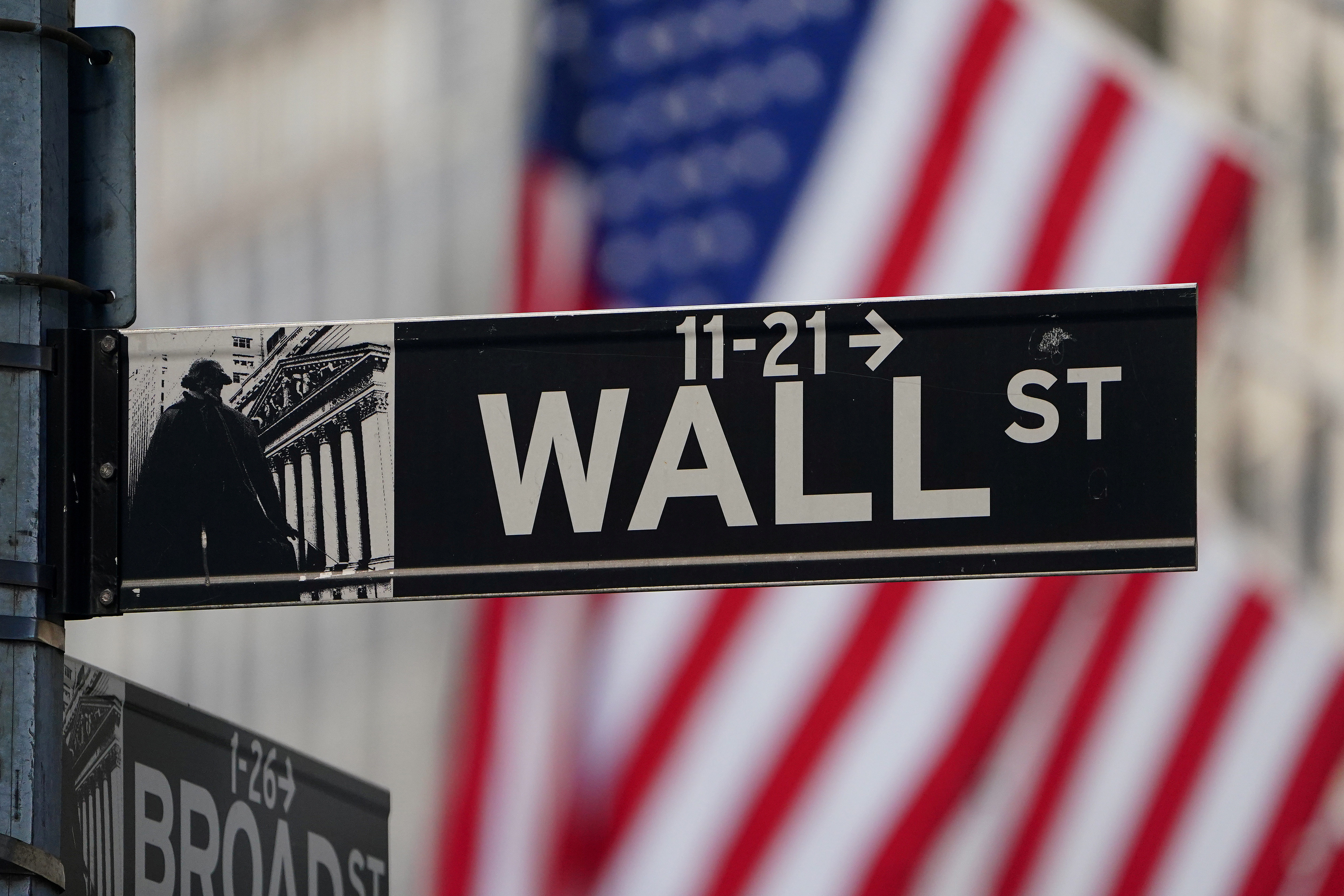 The Wall Street sign is pictured at the New York Stock exchange (NYSE) in the Manhattan borough of New York City, New York, U.S., March 9, 2020. REUTERS/Carlo Allegri/File Photo - RC273M9O3BKB