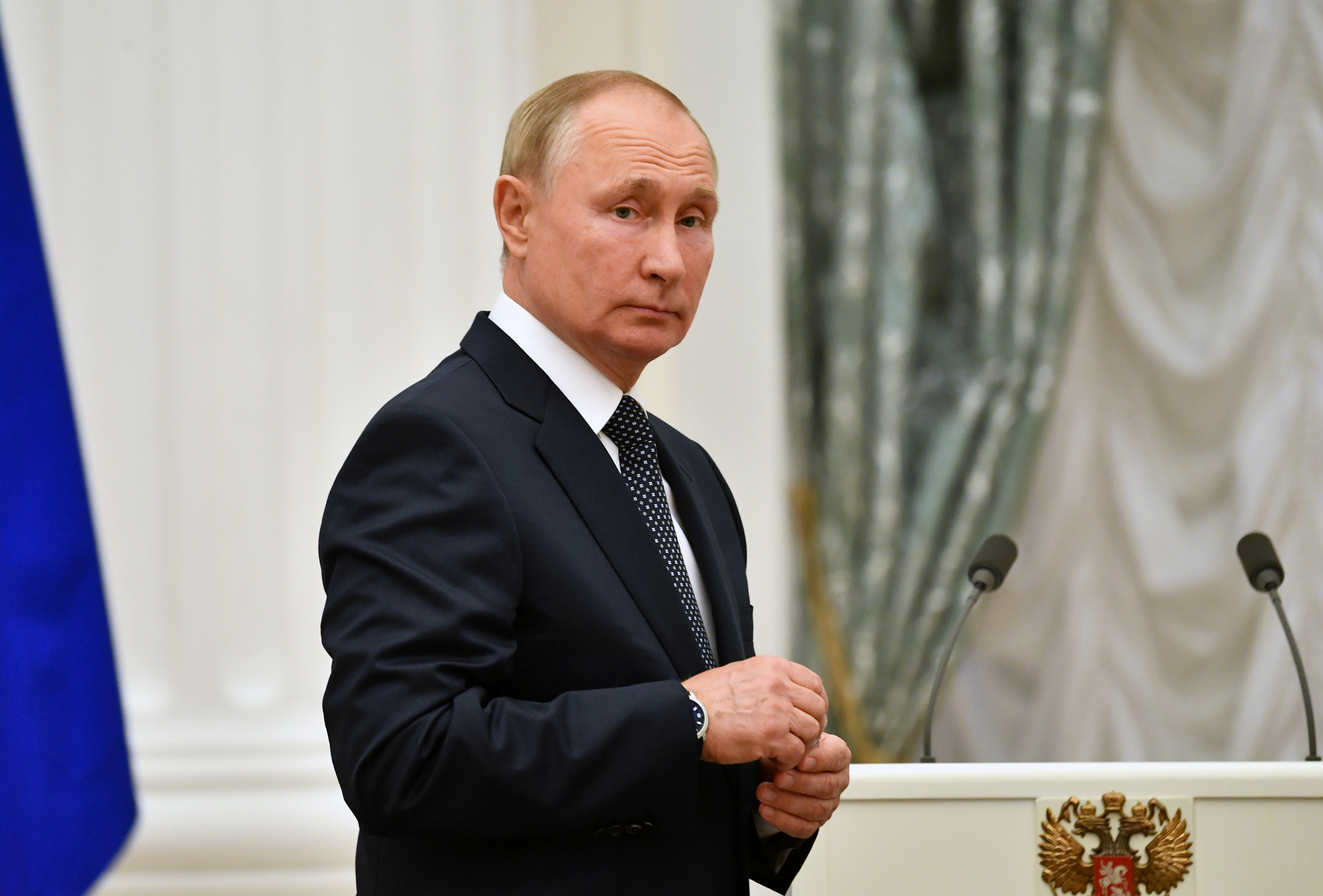 Russian President Vladimir Putin looks on during a meeting with athletes, participants of the 2020 Tokyo Olympic Games, in Moscow, Russia September 11, 2021.  Sputnik/Evgeny Biyatov/Kremlin via REUTERS