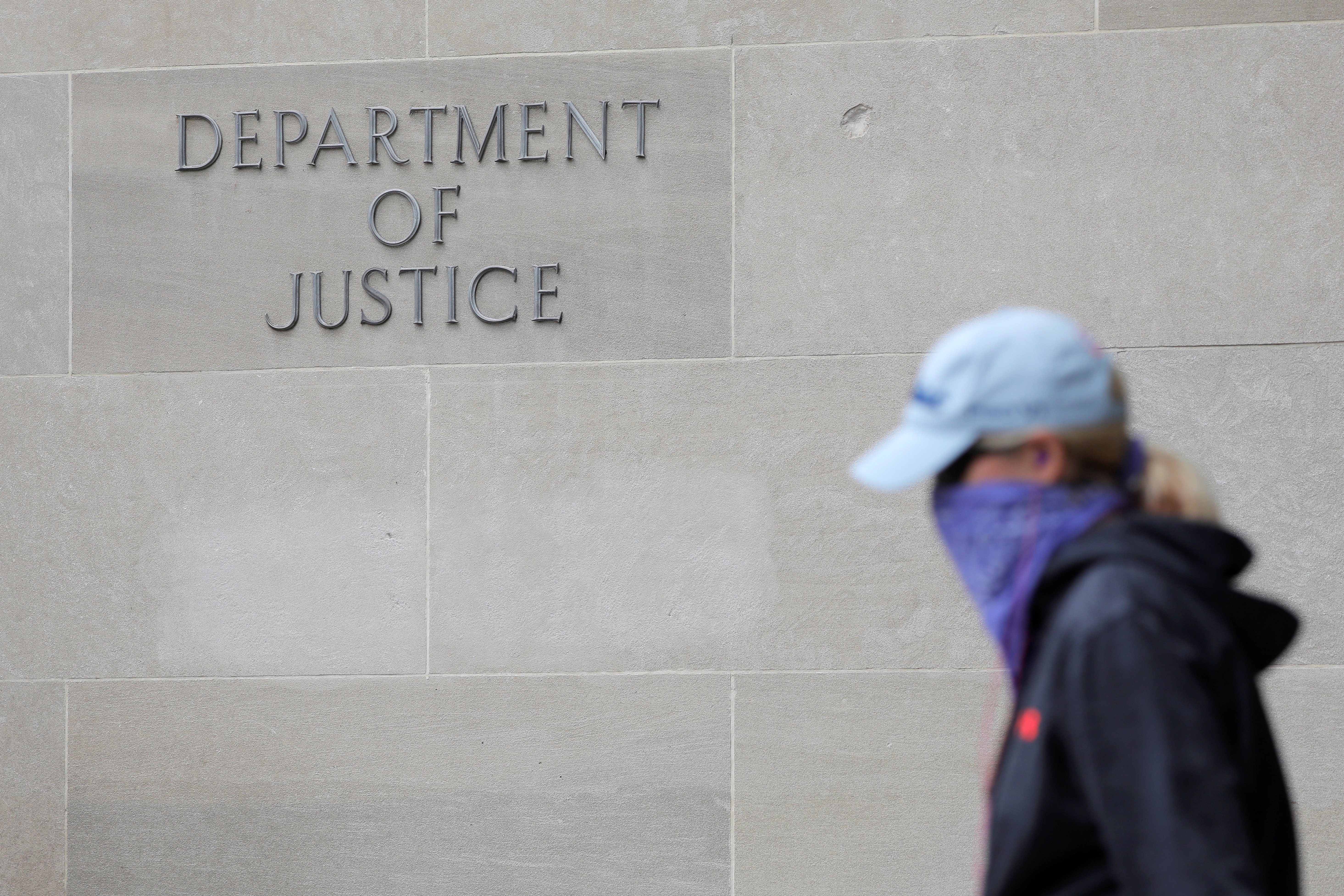 Signage is seen at the headquarters of the United States Department of Justice (DOJ) in Washington, D.C., U.S., May 10, 2021. REUTERS/Andrew Kelly