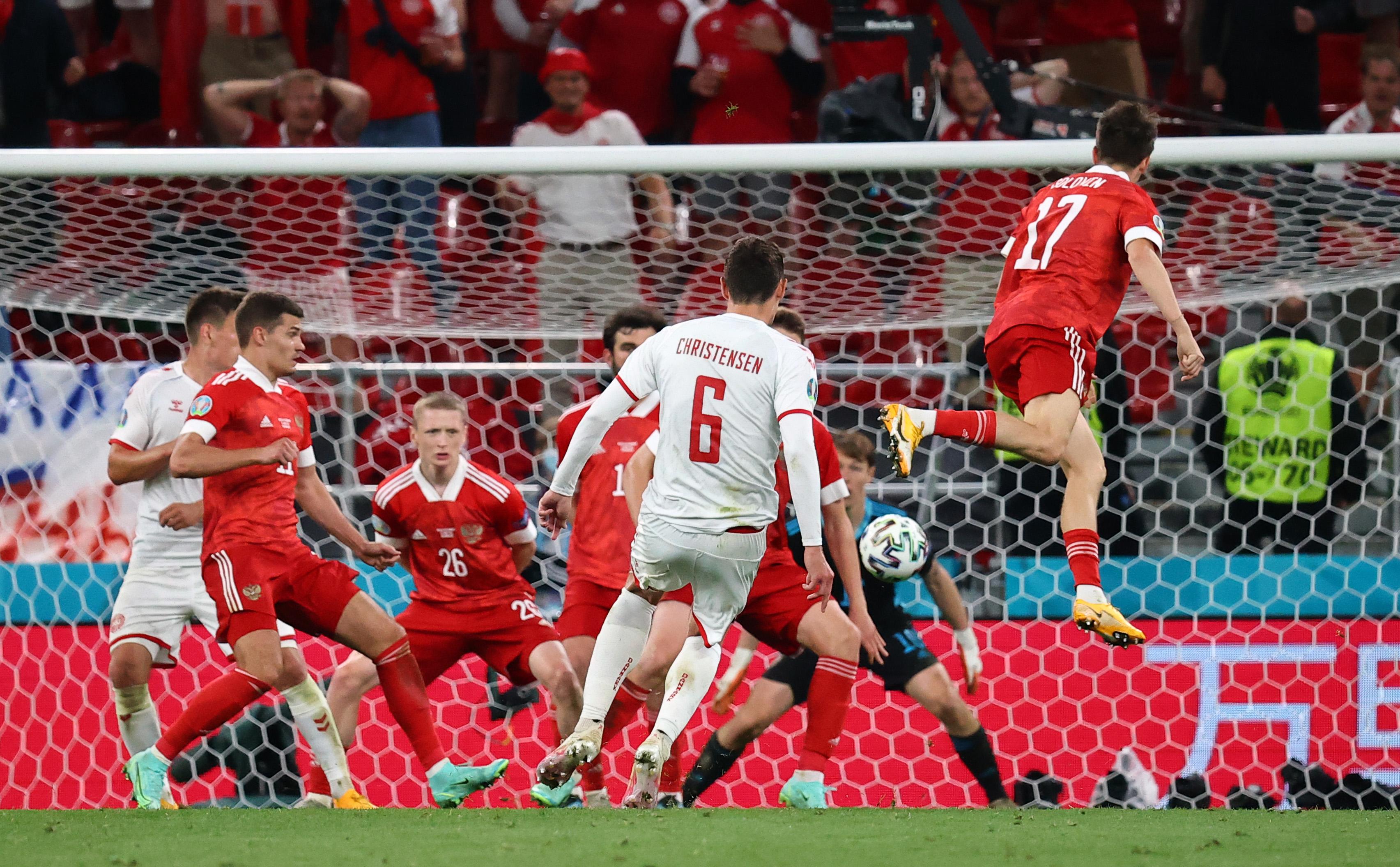 Soccer Football - Euro 2020 - Group B - Russia v Denmark - Parken Stadium, Copenhagen, Denmark - June 21, 2021 Denmark's Andreas Christensen scores their third goal Pool via REUTERS/Wolfgang Rattay