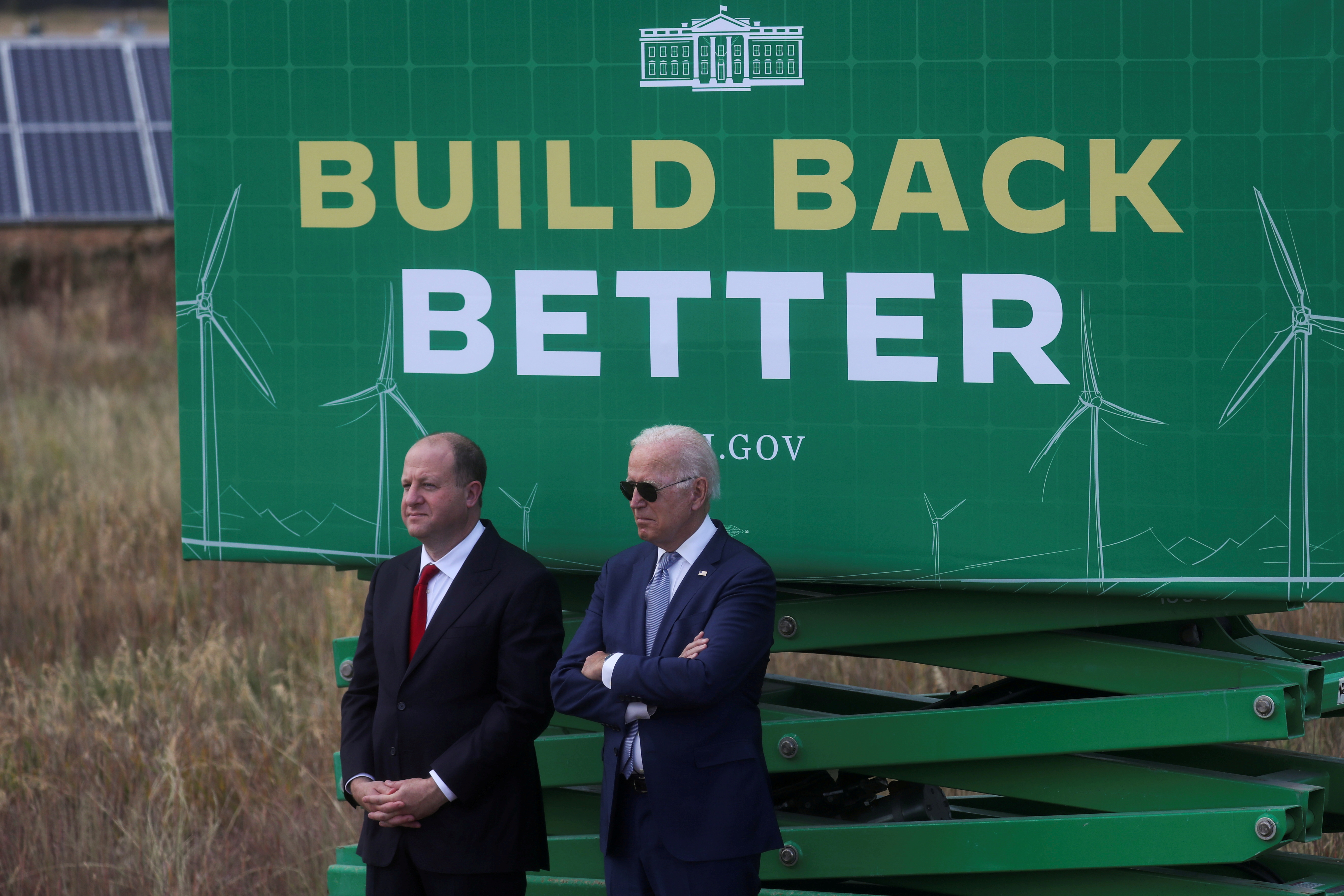 U.S. President Joe Biden stands next to Governor of Colorado Jared Polis during a visit to the Flatirons Campus Laboratories and Offices of the National Renewable Energy Laboratory (NREL), in Arvada, Colorado, U.S. September 14, 2021. REUTERS/Leah Millis
