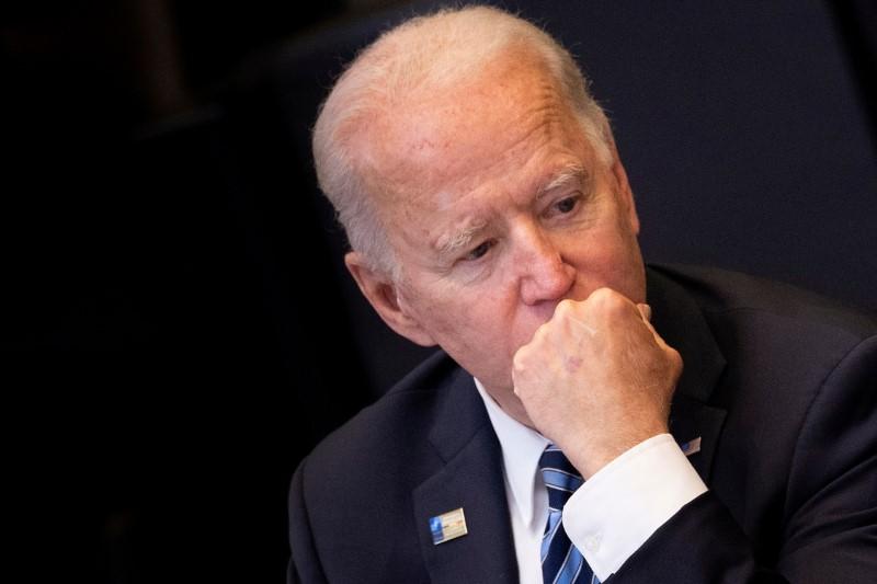 U.S. President Joe Biden listens during a plenary session at a NATO summit in Brussels, Belgium, June 14, 2021. Brendan Smialowski/Pool via REUTERS