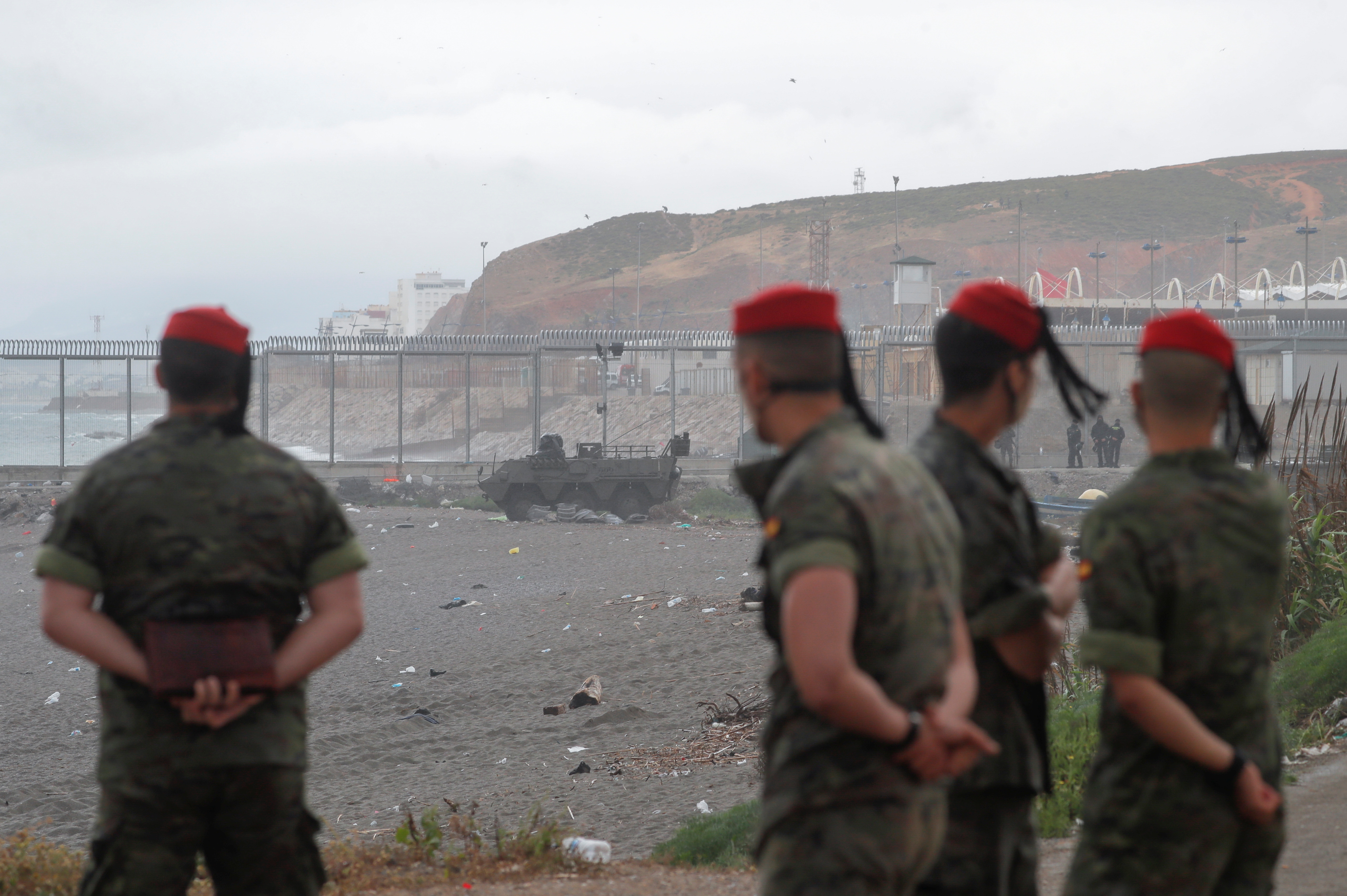Spanish soldiers are seen at El Tarajal Beach near the Spanish-Moroccan border, after thousands of migrants swam across this border during the last days, in Ceuta, Spain, May 20, 2021. REUTERS/Jon Nazca