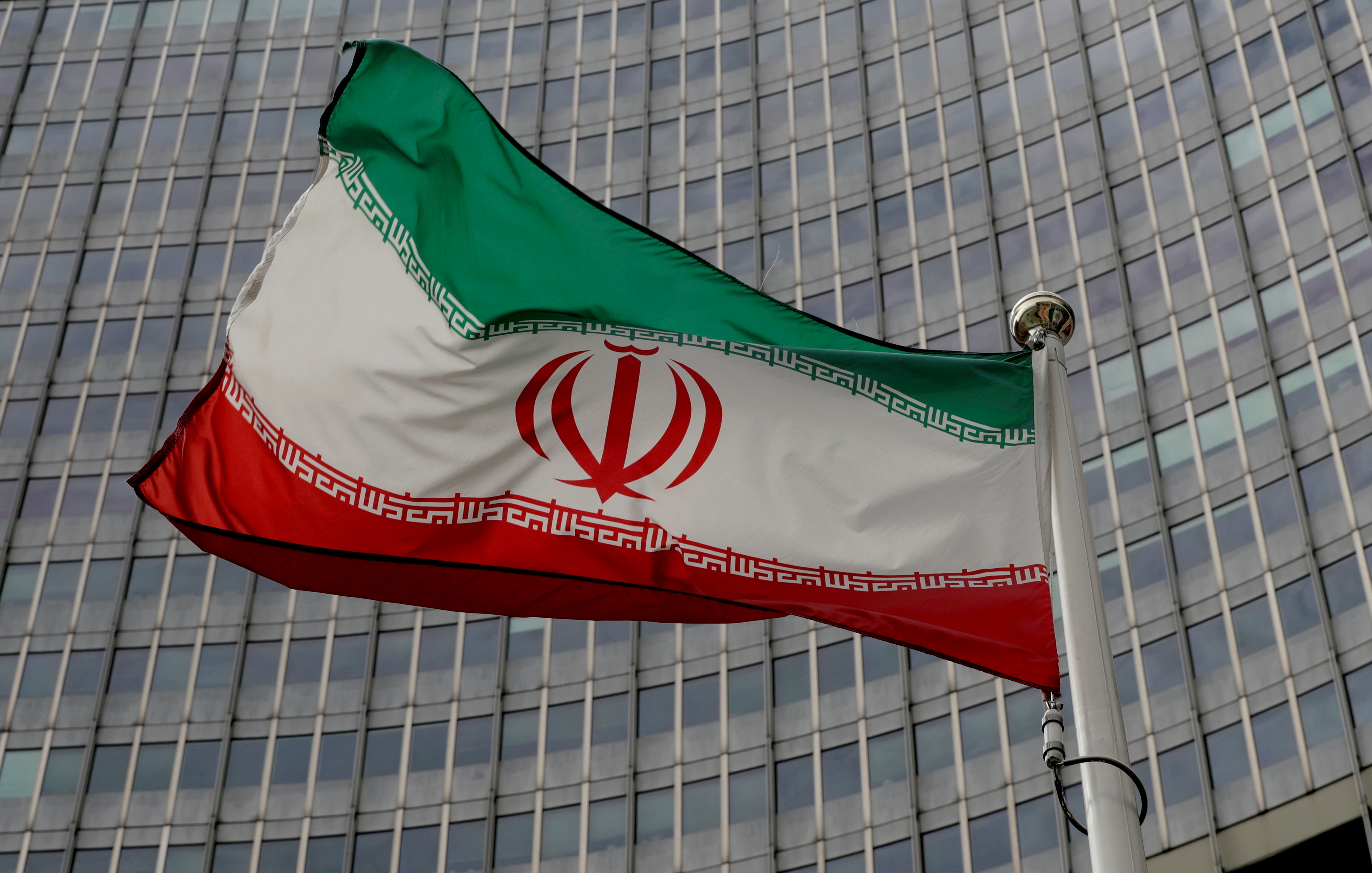 An Iranian flag flutters in front of the International Atomic Energy Agency (IAEA) headquarters in Vienna, Austria, September 9, 2019.   REUTERS/Leonhard Foeger/File Photo
