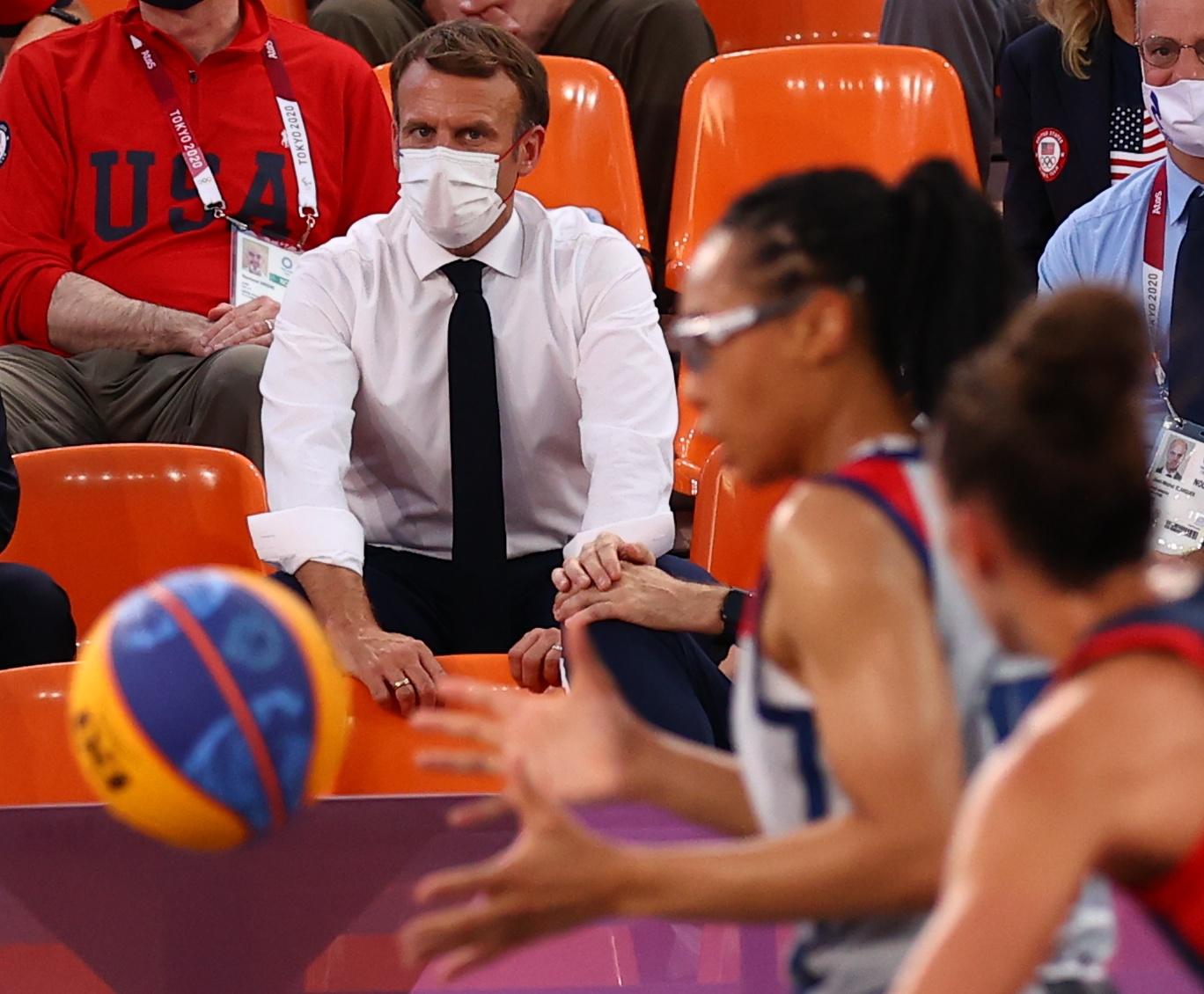 Tokyo 2020 Olympics - Basketball 3x3 - Women - Pool A - United States v France - Aomi Urban Sports Park, Tokyo, Japan - July 24, 2021. France president Emmanuel Macron  attends the match. REUTERS/Andrew Boyers