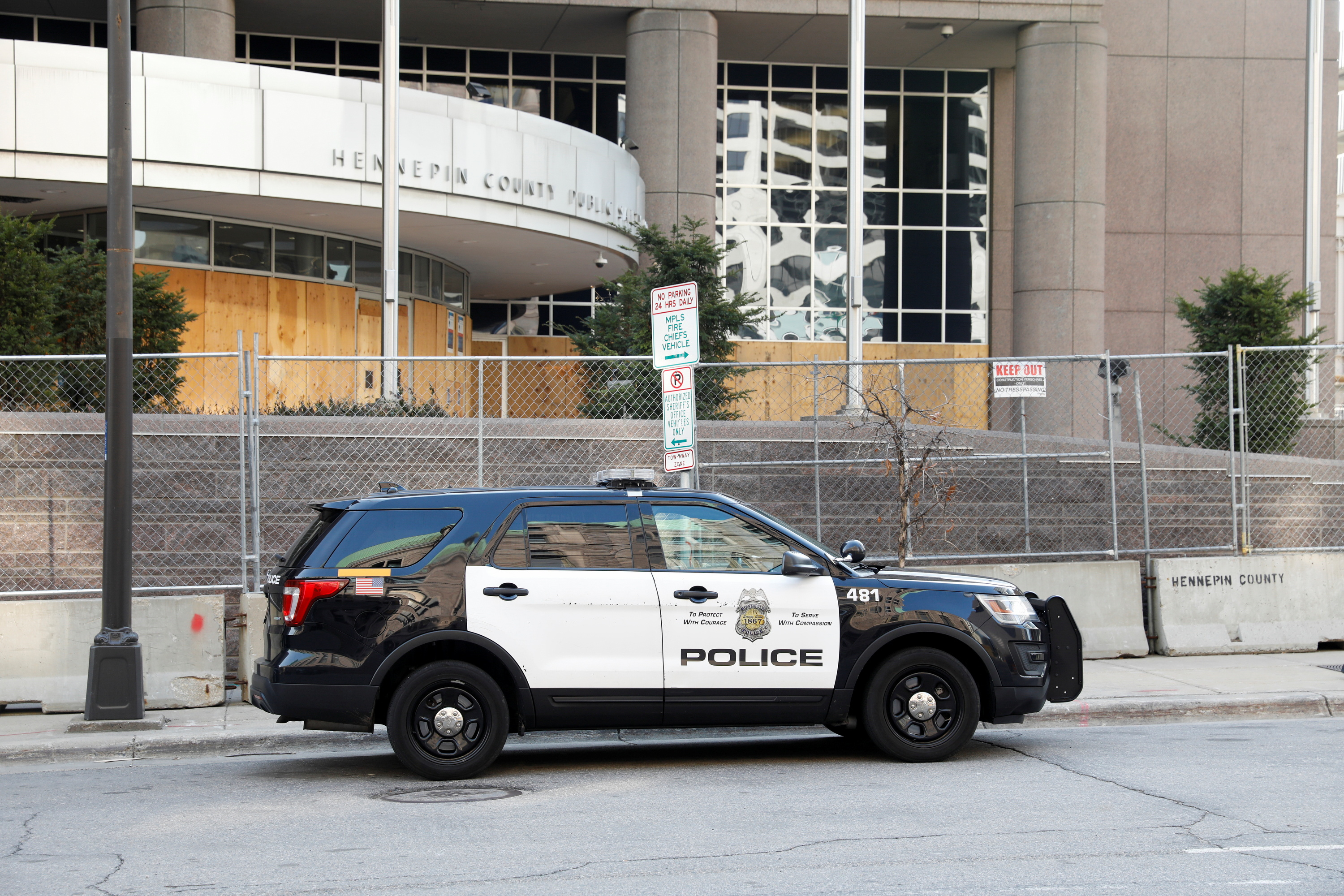 A Minneapolis Police Department vehicle is parked near the a boarded up Hennepin County Public Safety Facility, while the fifth day of trial continues for Derek Chauvin, who is facing murder charges in the death of George Floyd, in Minneapolis, Minnesota, U.S., April 2, 2021. REUTERS/Octavio Jones