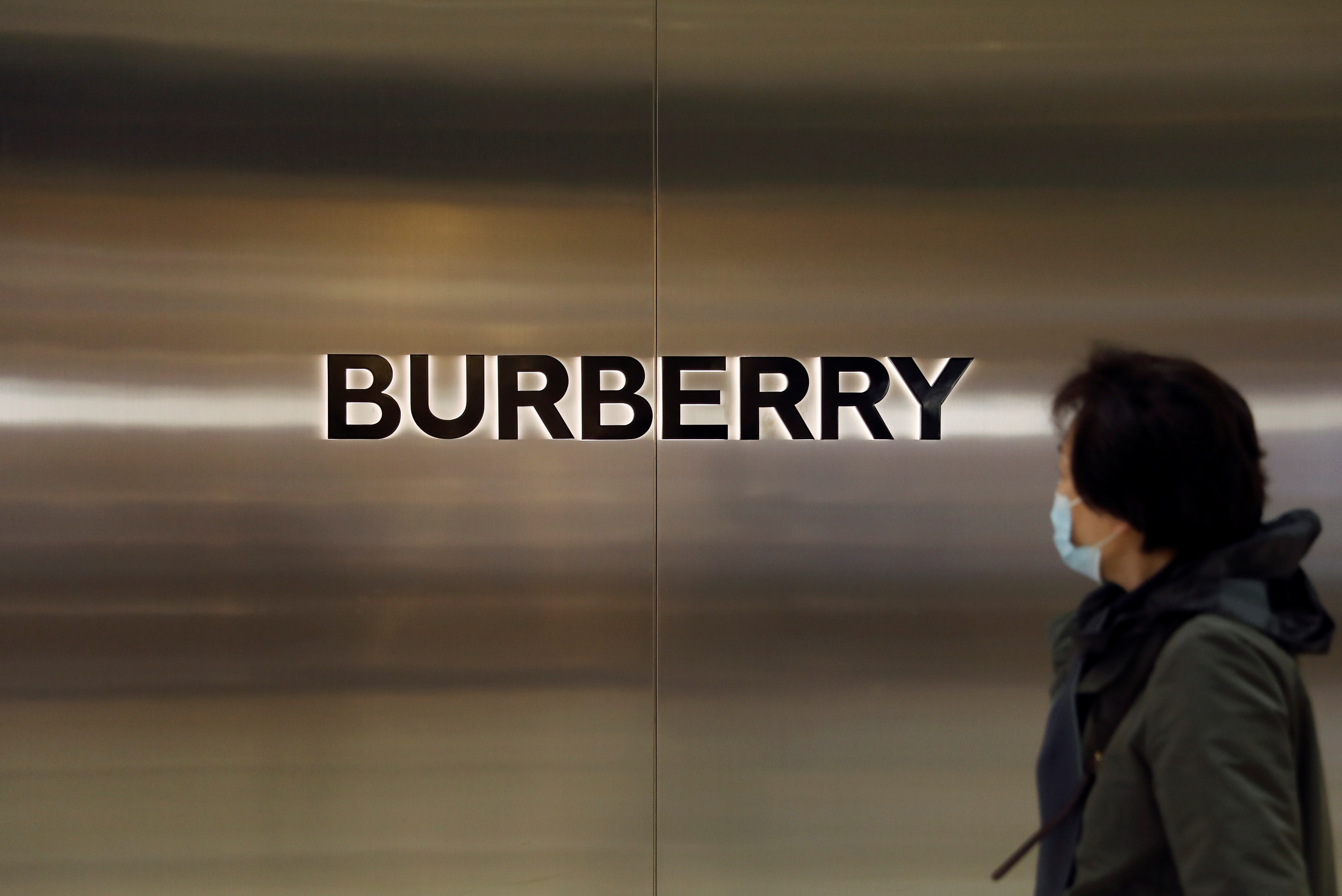A woman walks past a store of luxury brand Burberry at a shopping mall in Beijing, China March 26, 2021. REUTERS/Tingshu Wang