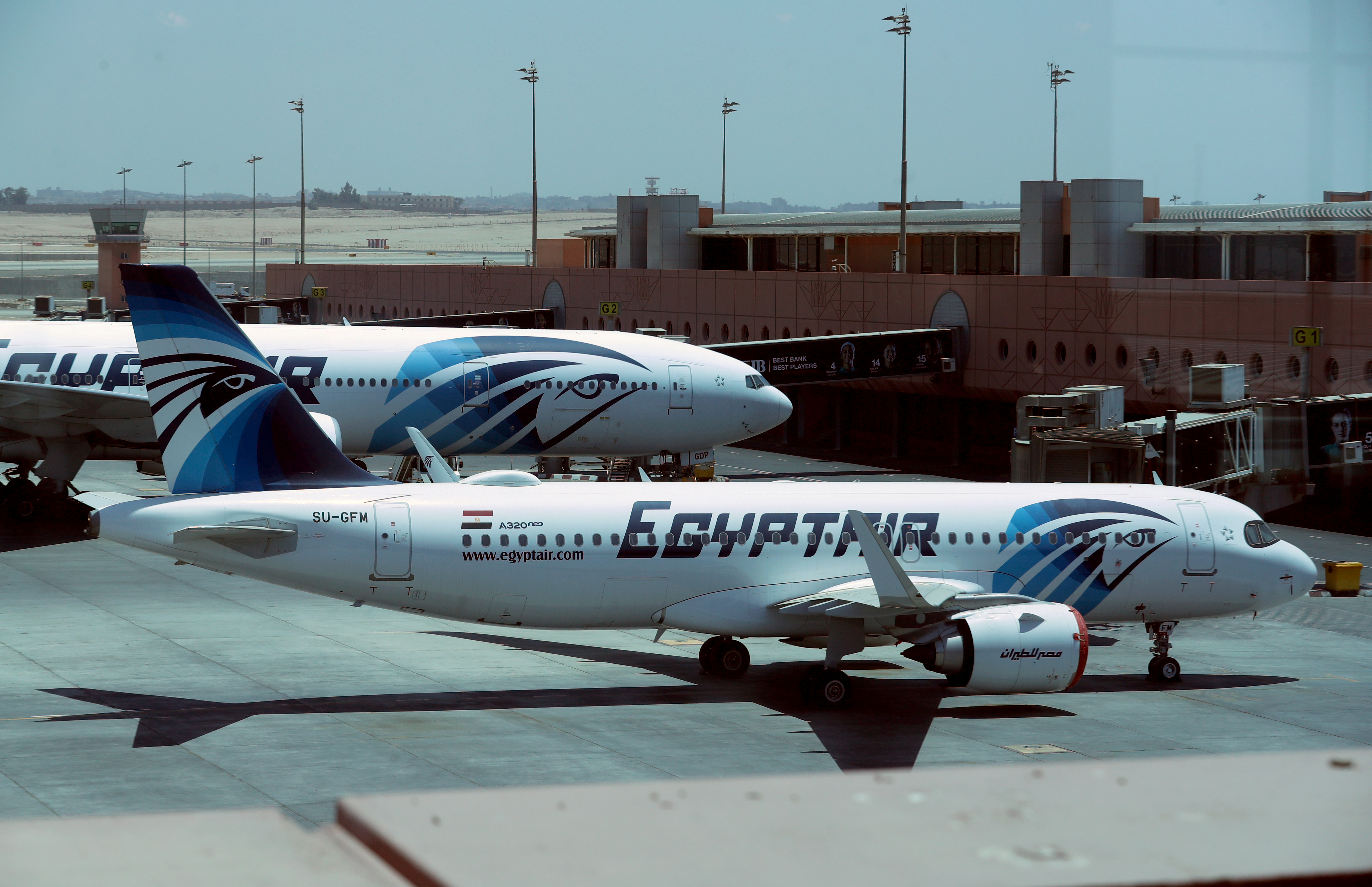 EgyptAir planes are seen on the tarmac, following an outbreak of the coronavirus disease (COVID-19), at Cairo International Airport in Cairo, Egypt, June 18, 2020. REUTERS/Mohamed Abd El Ghany