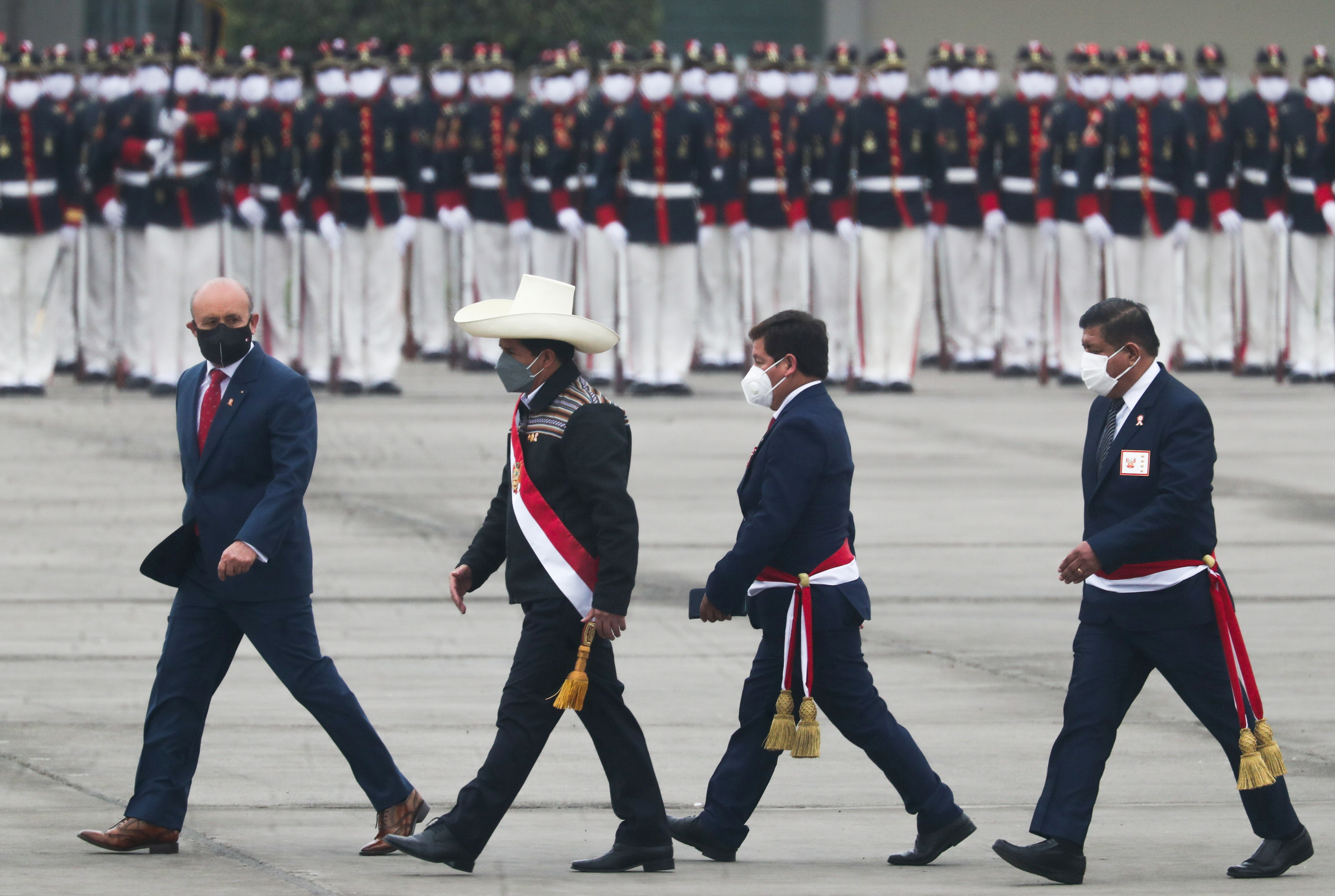 Peru's President Pedro Castillo attends a military parade with Prime Minister Guido Bellido Ugarte, and Defence Minister Walter Ayala, during Independence Day celebrations, in Lima, Peru, July 30, 2021. REUTERS/Sebastian Castaneda/File Photo