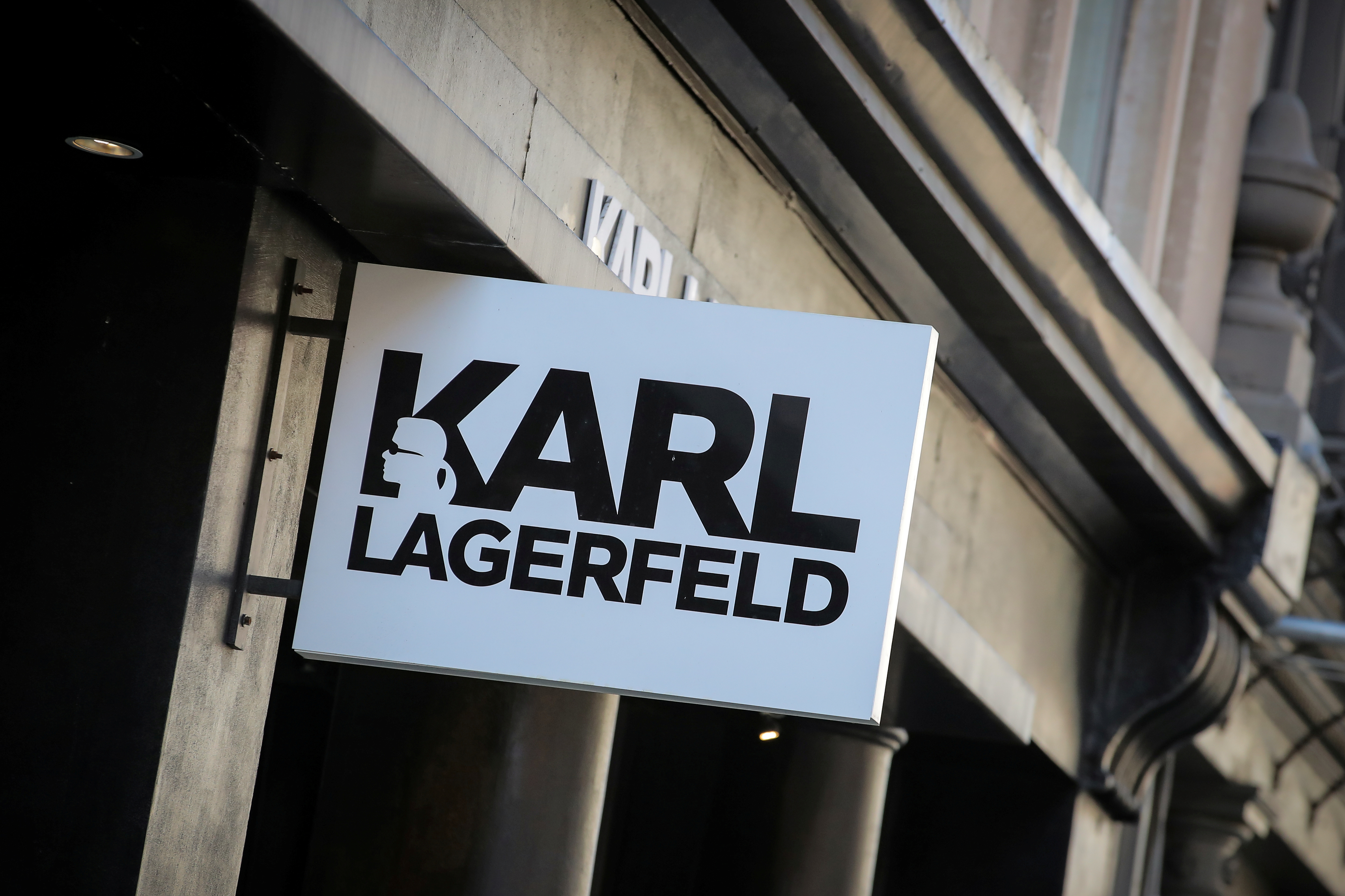 A sign and logo are seen on the Karl Lagerfeld store in New York City, U.S., February 19, 2019. REUTERS/Brendan McDermid/File Photo