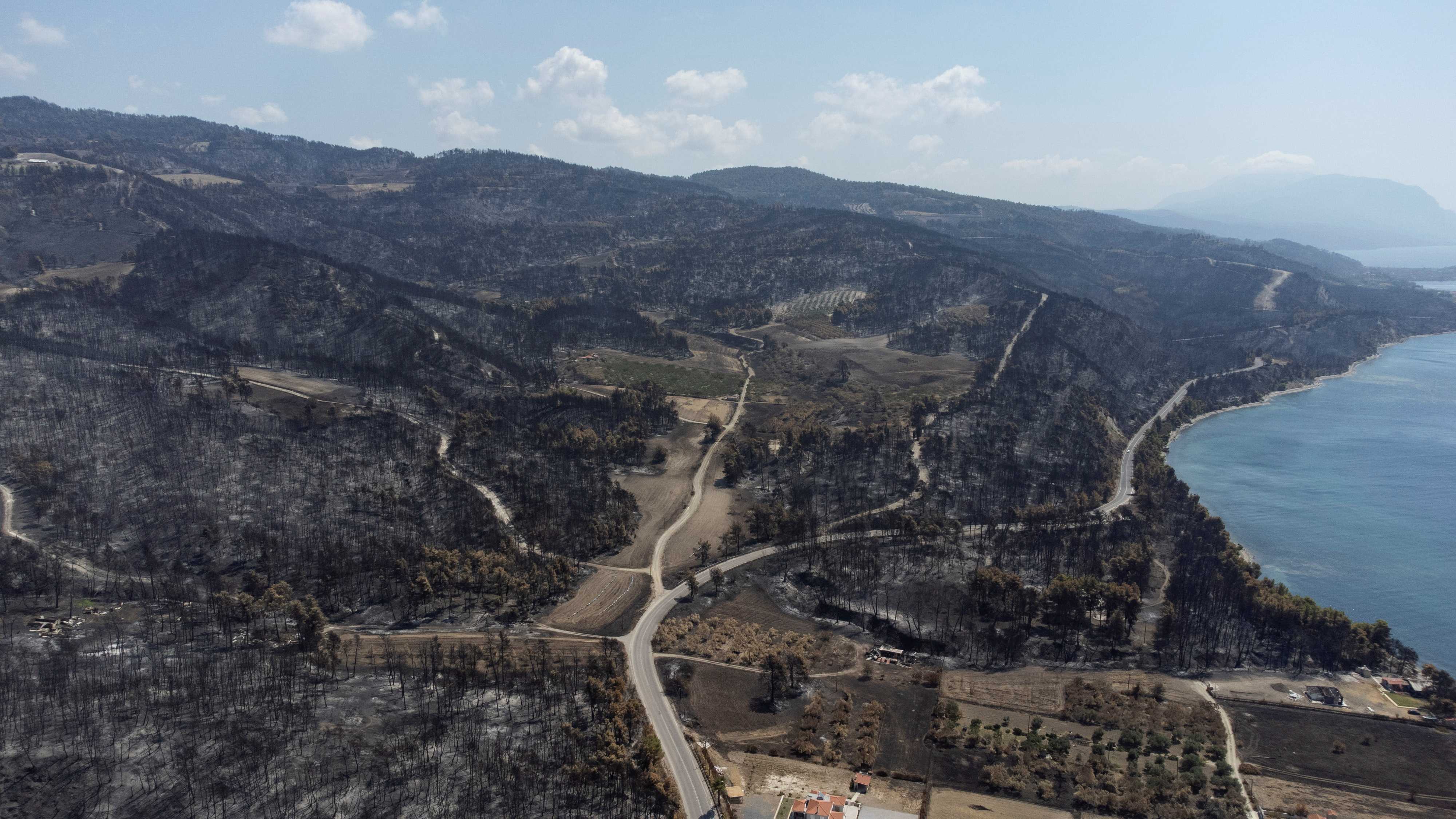 Burnt hillsides are seen following a wildfire near the village of Rovies on the island of Evia, Greece, August 12, 2021. Picture taken with a drone. REUTERS/Alkis Konstantinidis