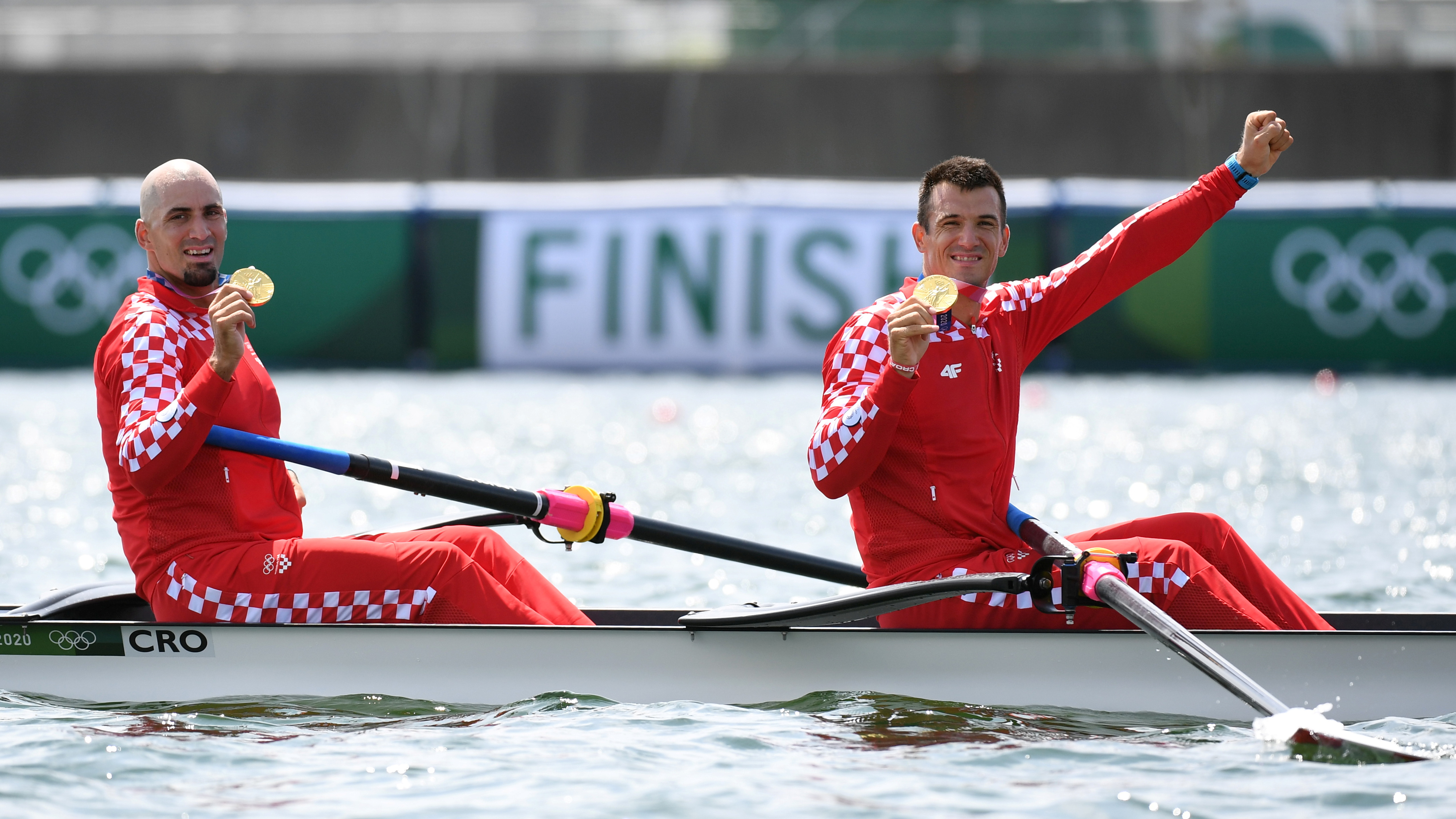 Tokyo 2020 Olympics - Rowing - Men's Pair - Medal Ceremony - Sea Forest Waterway, Tokyo, Japan - July 29, 2021 Gold medallists Martin Sinkovic of Croatia and Valent Sinkovic of Croatia celebrate in their boat with their medals REUTERS/Piroschka Van De Wouw