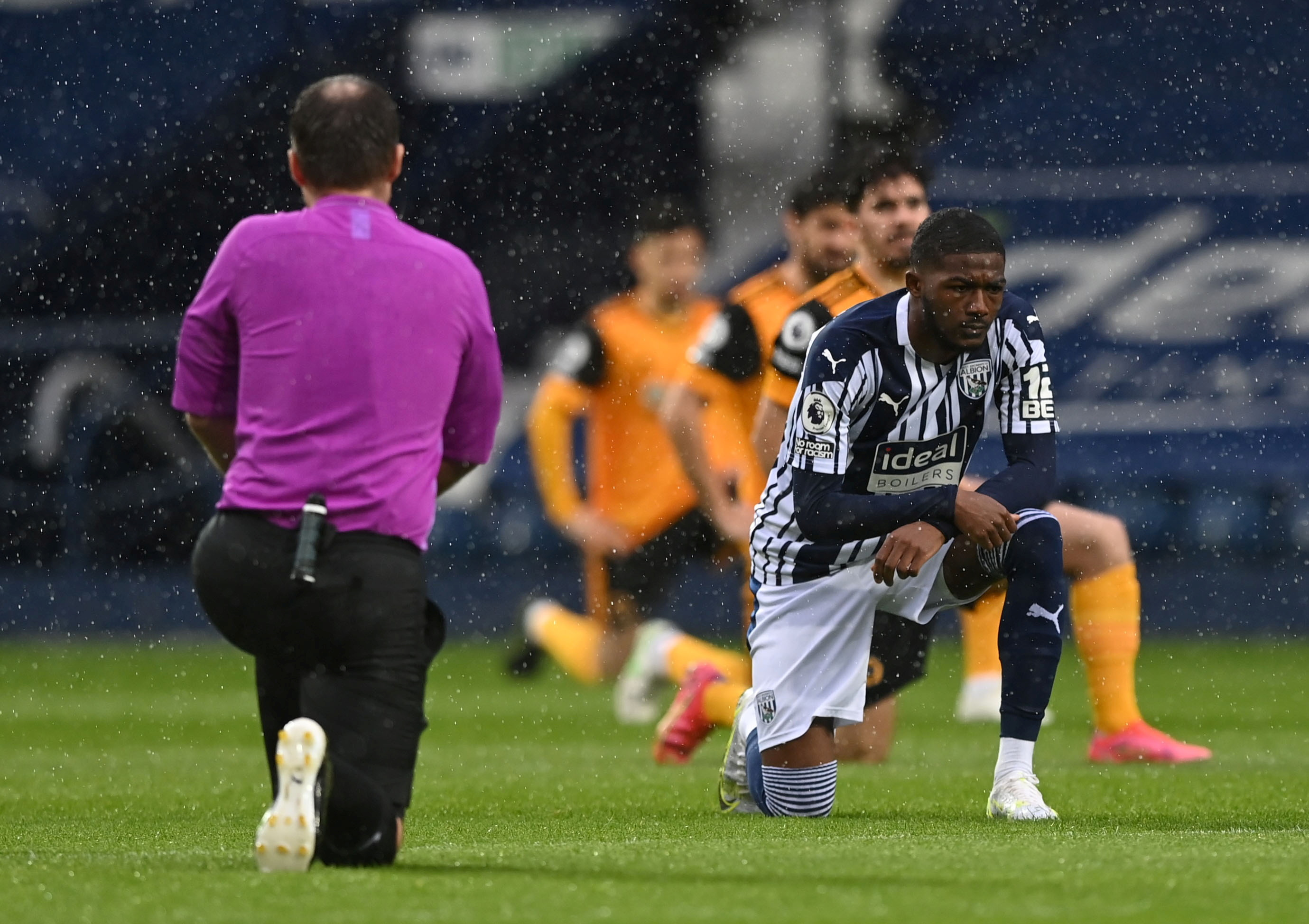 Soccer Football - Premier League - West Bromwich Albion v Wolverhampton Wanderers - The Hawthorns, West Bromwich, Britain - May 3, 2021 West Bromwich Albion's Ainsley Maitland-Niles takes a knee before the match Pool via REUTERS/Shaun Botterill EDITORIAL USE ONLY. No use with unauthorized audio, video, data, fixture lists, club/league logos or 'live' services. Online in-match use limited to 75 images, no video emulation. No use in betting, games or single club /league/player publications.  Please contact your account representative for further details./File Photo