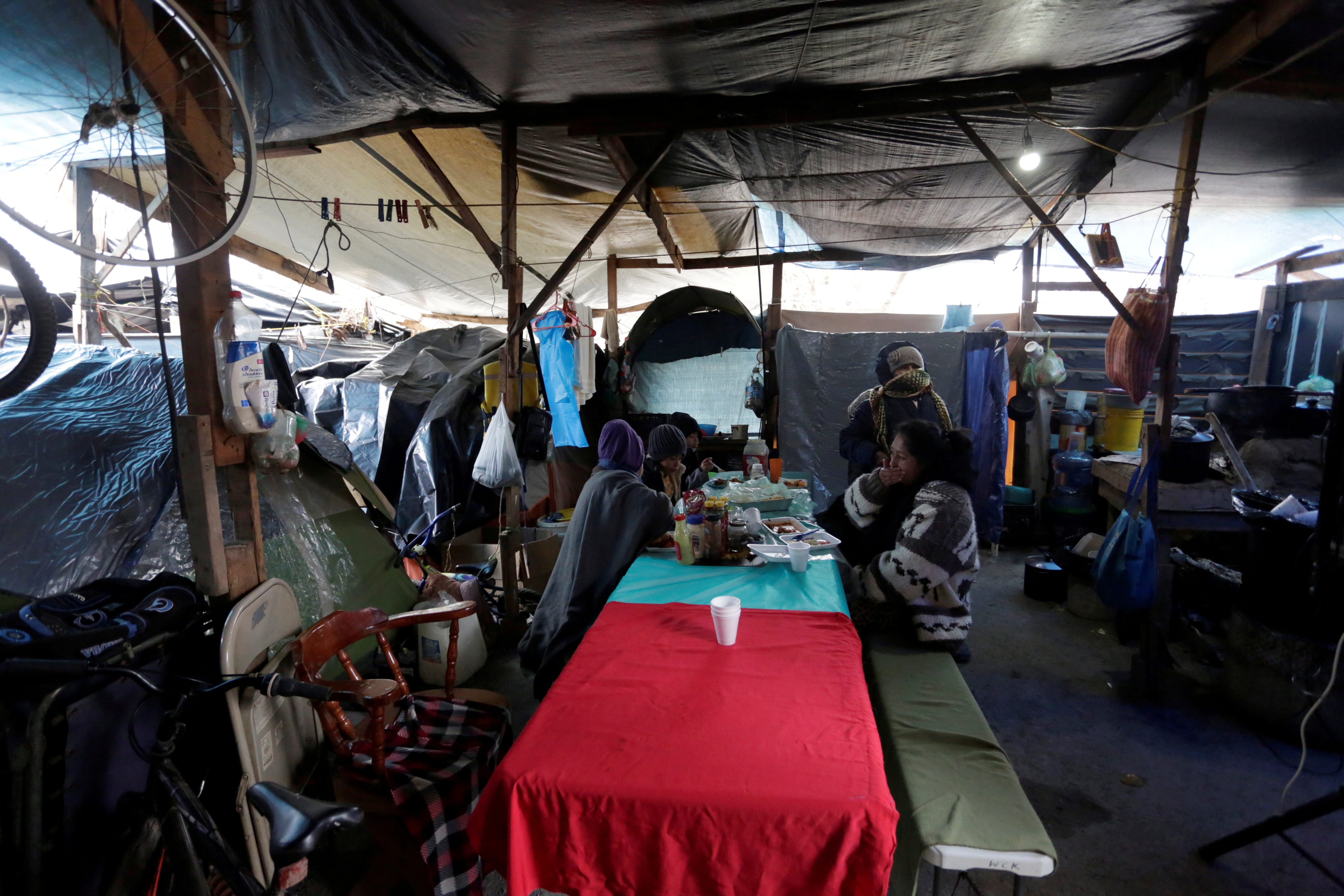 Migrants who traveled to northern Mexico seeking asylum in the United States, are pictured at a migrant encampment in Matamoros, Mexico February 18, 2021. REUTERS/Daniel Becerril/File Photo