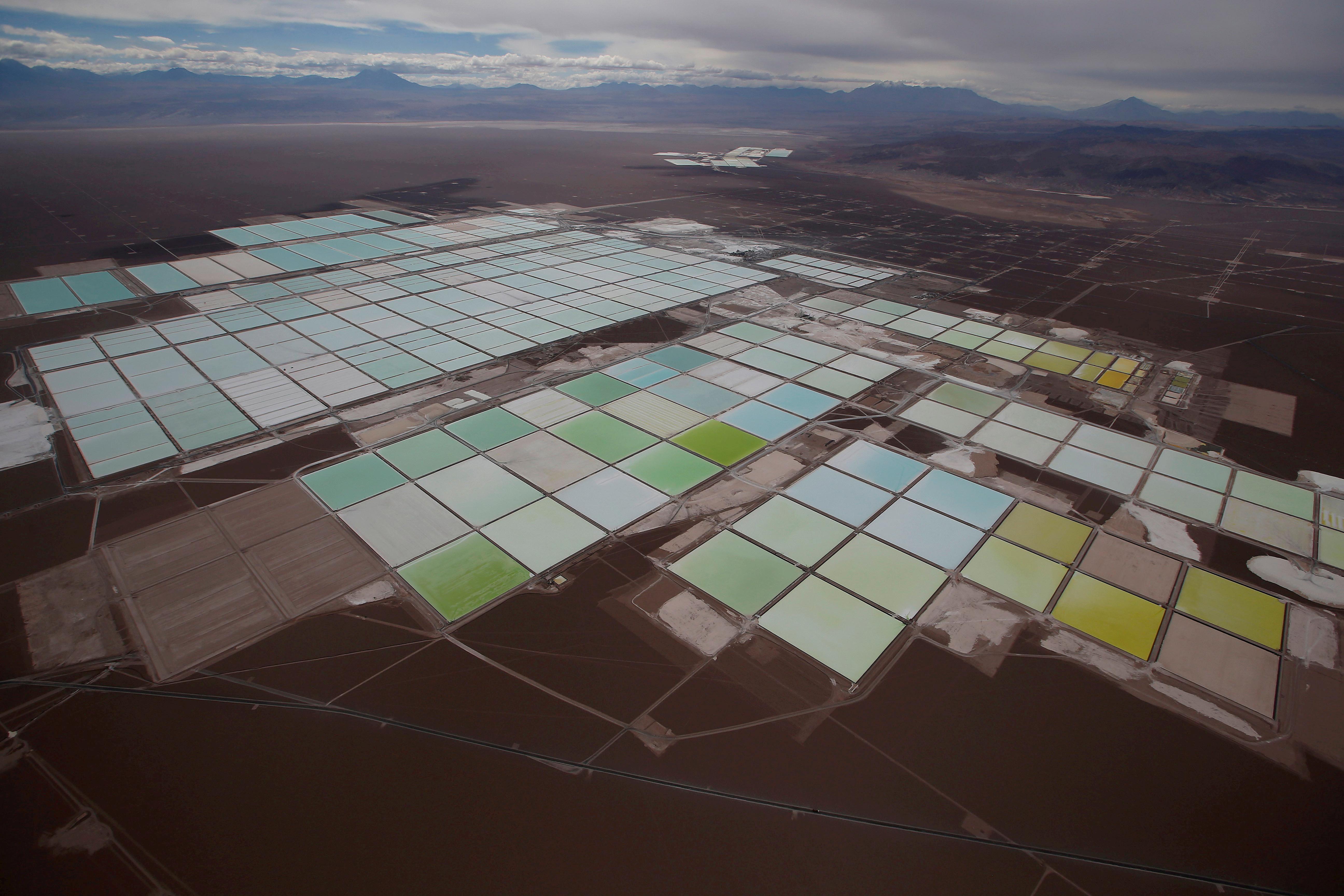 An aerial view shows the brine pools of SQM lithium mine on the Atacama salt flat in the Atacama desert of northern Chile, January 10, 2013. REUTERS/Ivan Alvarado