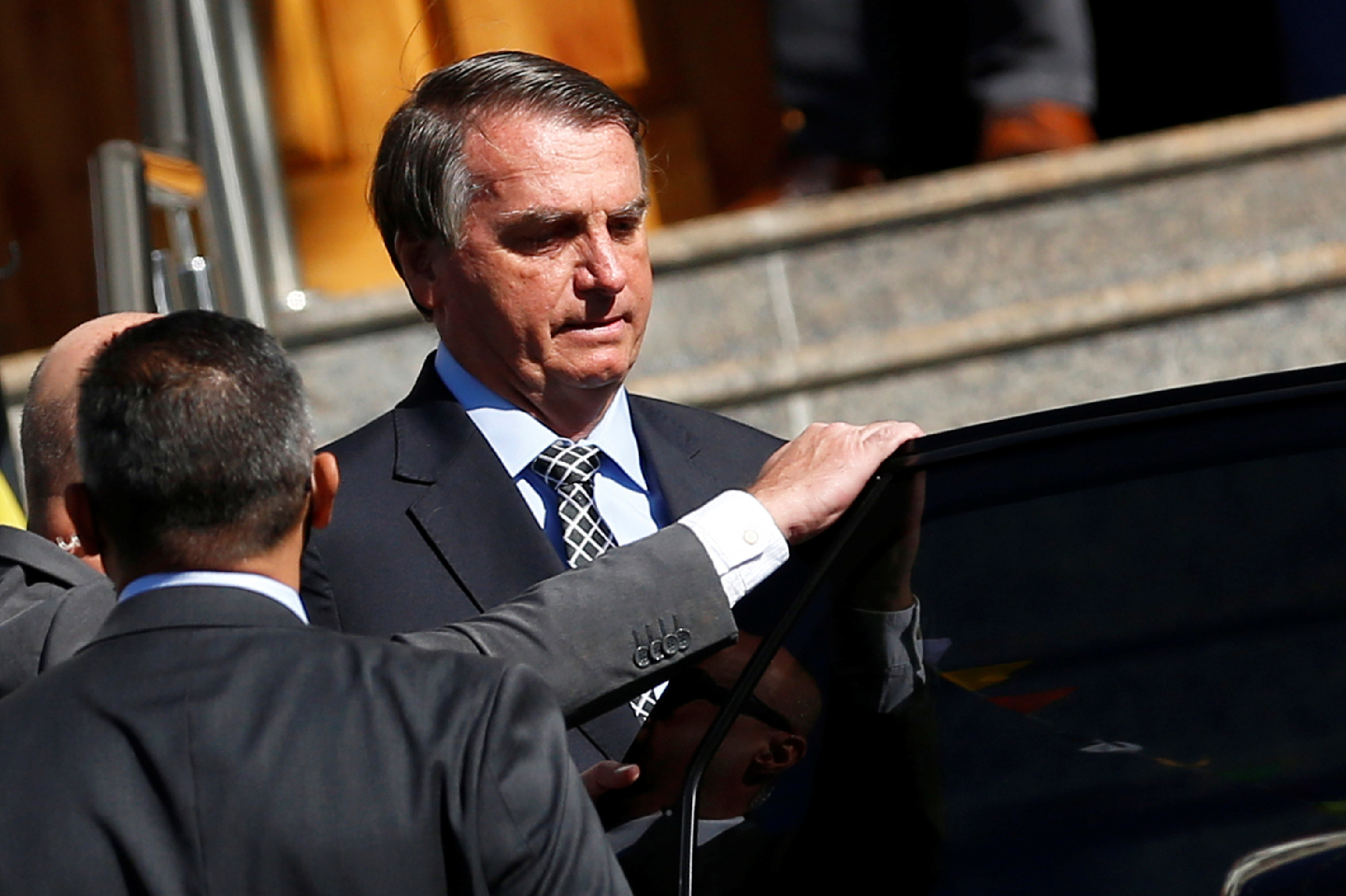 Brazil's President Jair Bolsonaro gets in a vehicle after attending Mass at a Catholic church in Brasilia, Brazil July 1, 2021. REUTERS/Adriano Machado