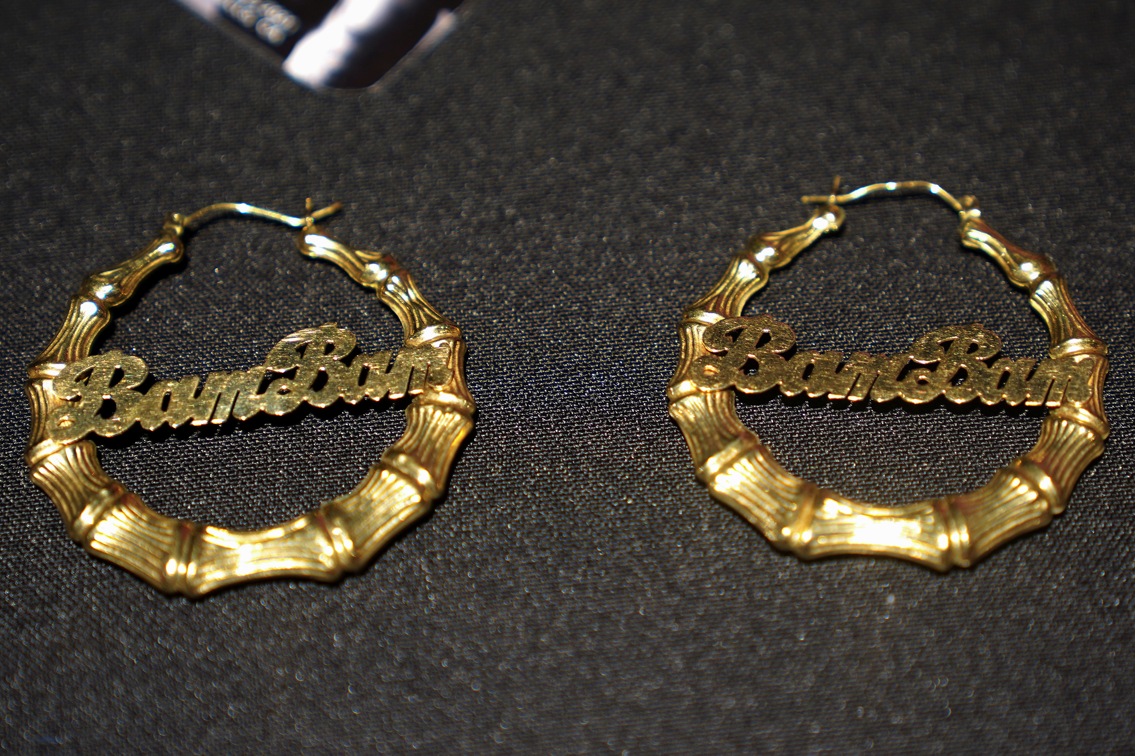 A pair of earrings worn by Amy Winehouse are pictured at a preview for an auction of her personal items on the tenth anniversary of her death in the Manhattan borough of New York City, New York, U.S., October 11, 2021.  REUTERS/Carlo Allegri