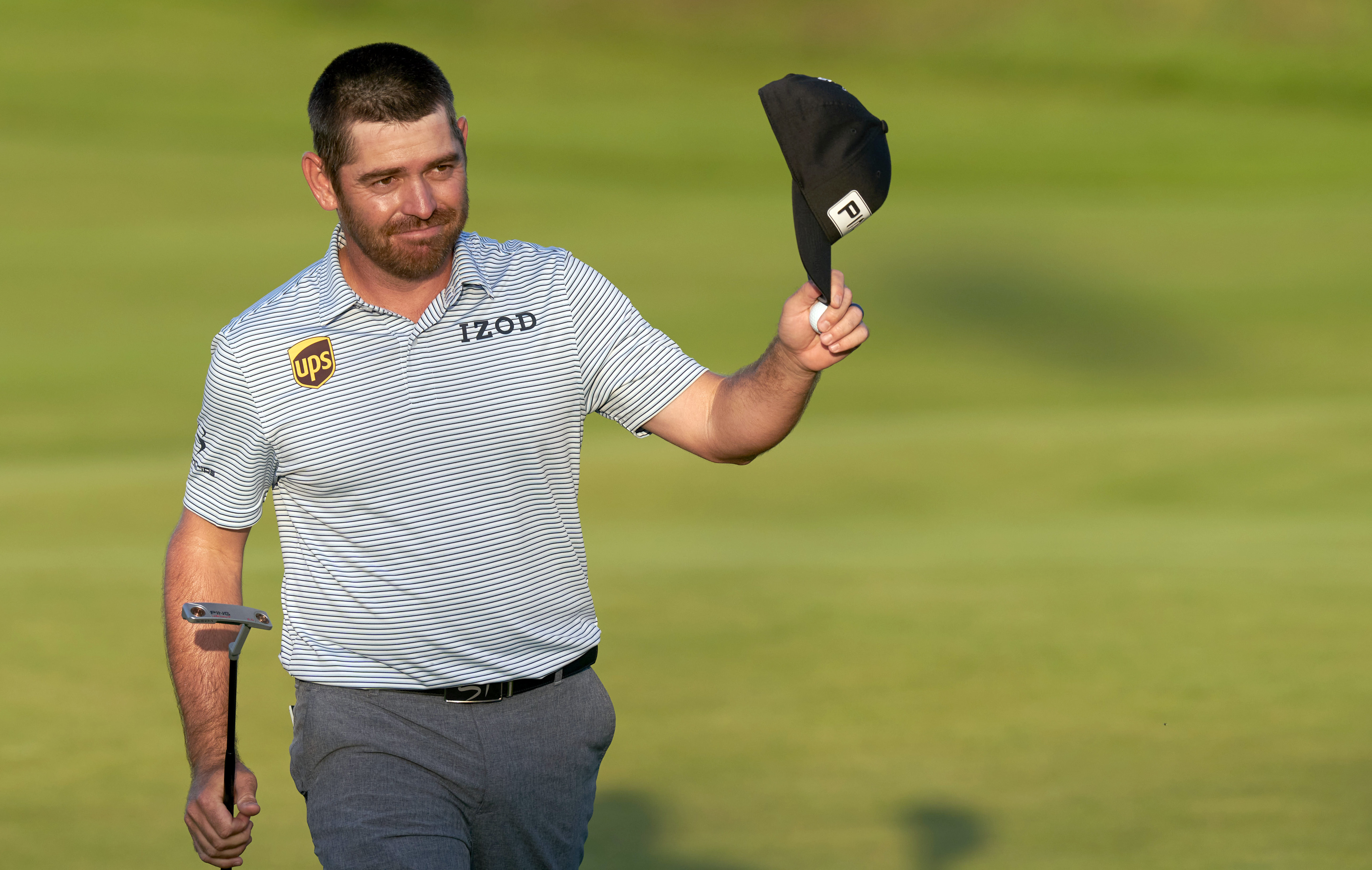 Jul 17, 2021; Sandwich, England, GBR; Louis Oosthuizen acknowledges the gallery after his putt on the 18th green during the third round of the Open Championship golf tournament. Mandatory Credit: Peter van den Berg-USA TODAY Sports