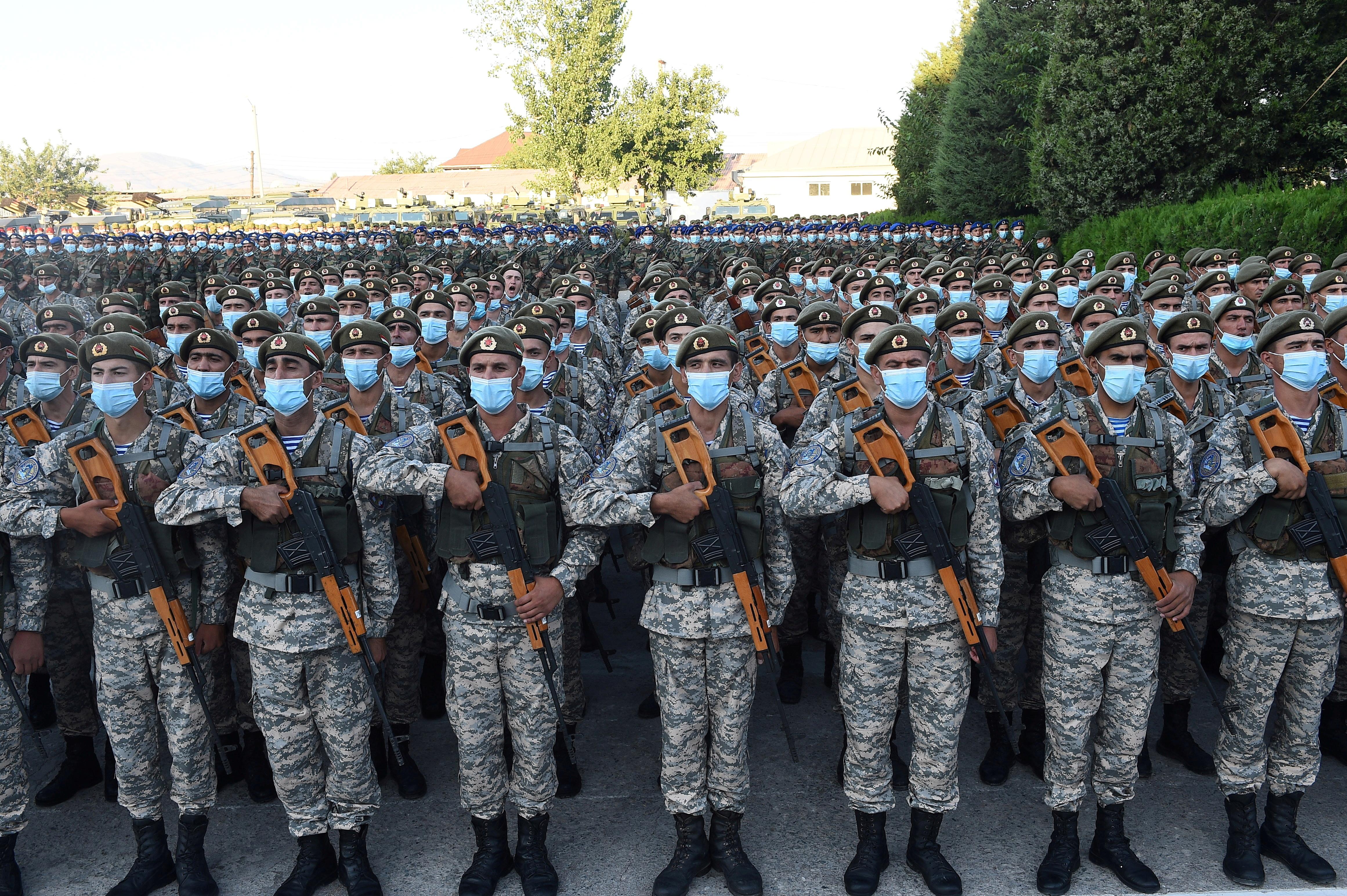 Tajik service members line up during a parade following a nationwide military exercise, in Dushanbe, Tajikistan July 22, 2021. Tajik Presidential Press Service/Handout via REUTERS