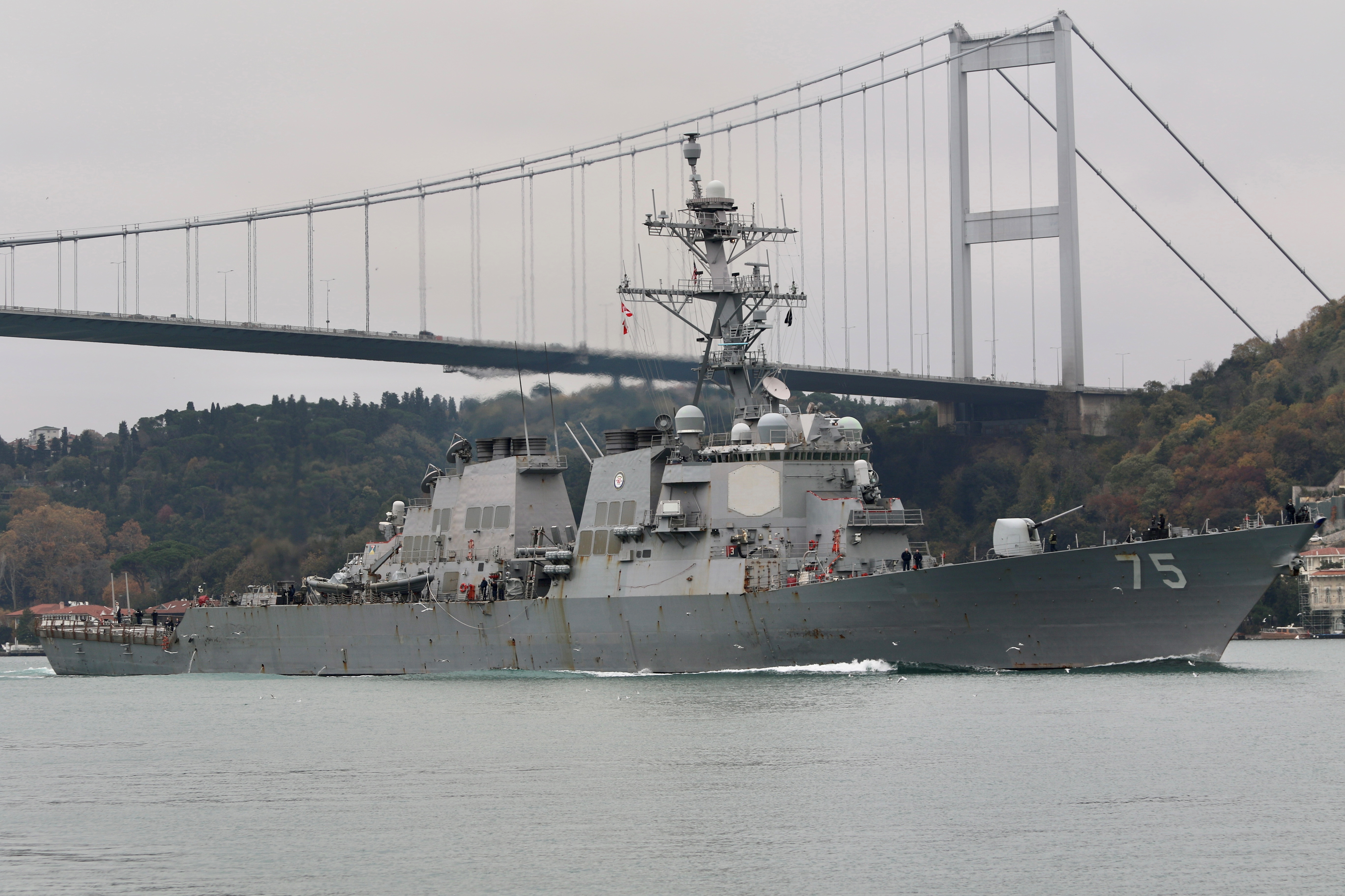 The U.S. Navy Arleigh Burke-class guided-missile destroyer USS Donald Cook (DDG 75) sets sail in the Bosphorus, on its way to the Black Sea, in Istanbul, Turkey December 2, 2020.  REUTERS/Yoruk Isik