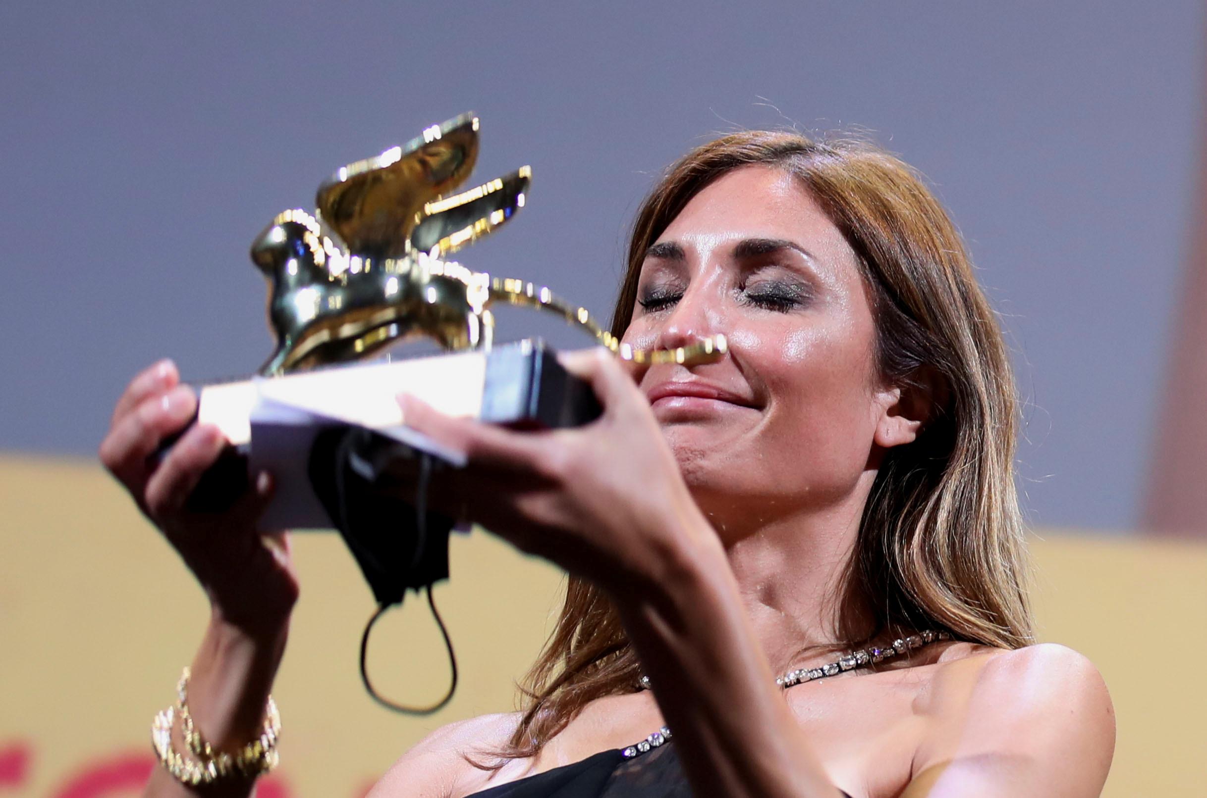 The 78th Venice Film Festival - Awards Ceremony - Venice, Italy, September 11, 2021 - Director Audrey Diwan receives the Golden Lion award for Best Film. REUTERS/Yara Nardi